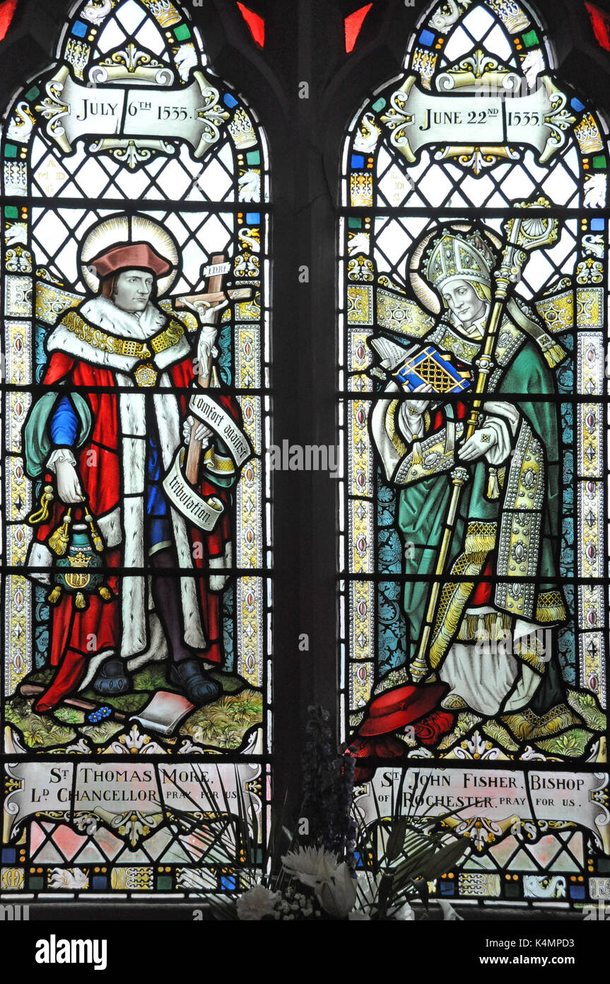 Thomas More, Lord Chancellor and St John Fisher, Bishop of Rochester, 1535, depicted in a victorian stained glass window in Fleetwood, Lancashire - Stock Image