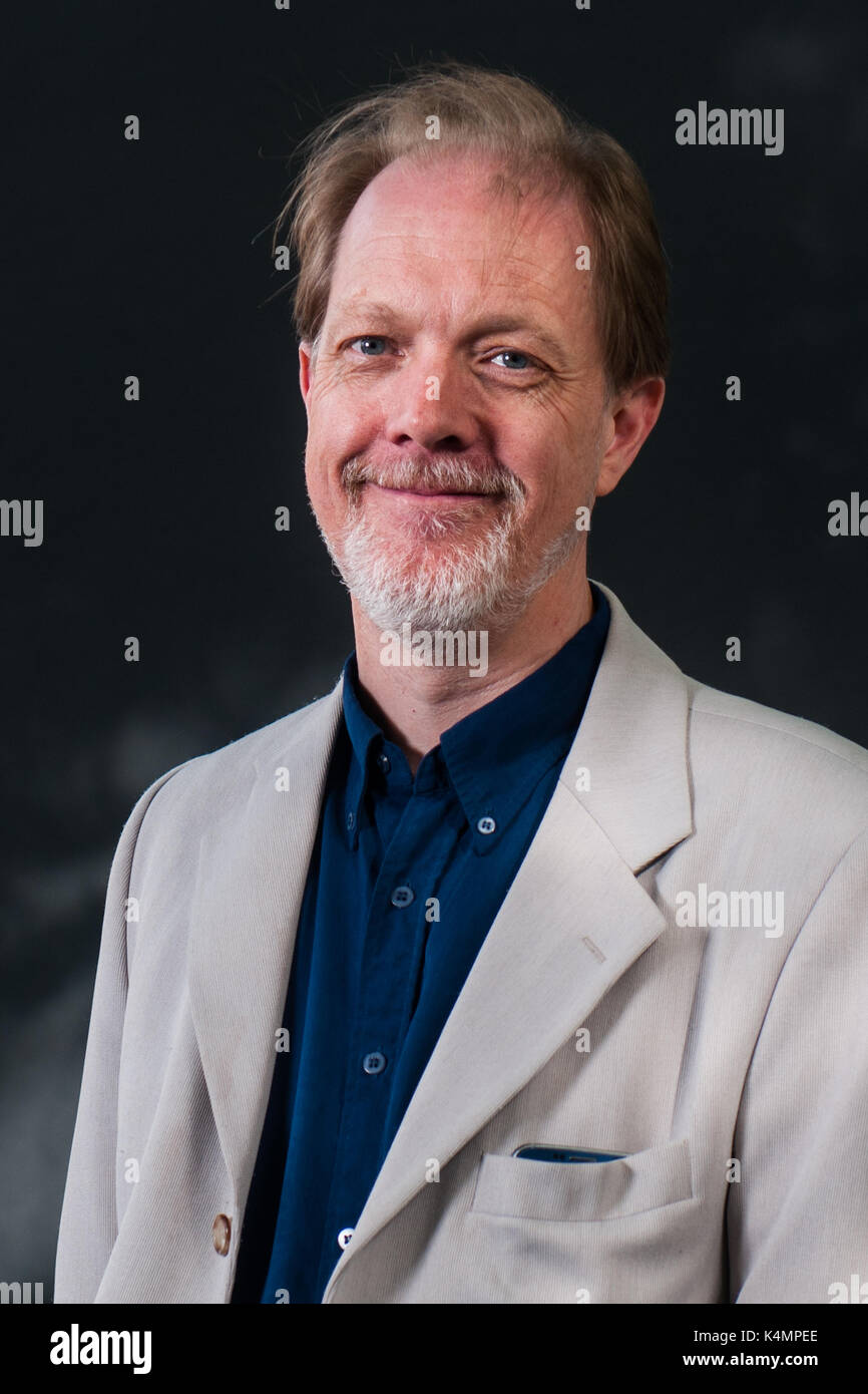 British science fiction and fantasy novelist Adam Roberts attends a  photocall during the Edinburgh International Book Festival on August 12,  2017 in E