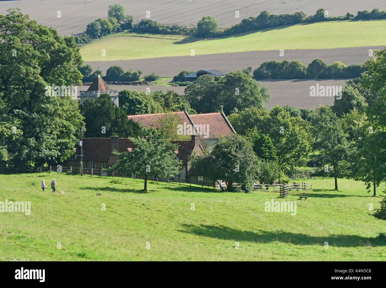 Chiltern Hills - Hughenden Valley - view to parish church - woodlands - fields - hillsides - walkers - sunlight - shadows - Stock Image