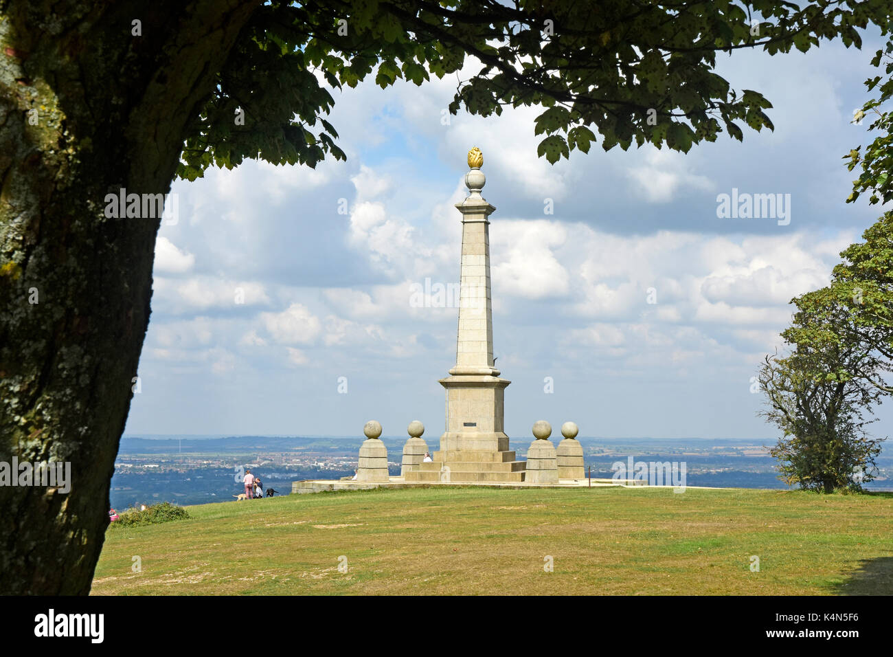 Chiltern Hills - Coombe Hill - imposing South African war  memorial - framed by trees - sunlight - cloud flecked blue sky - view over Aylesbury Plain - Stock Image