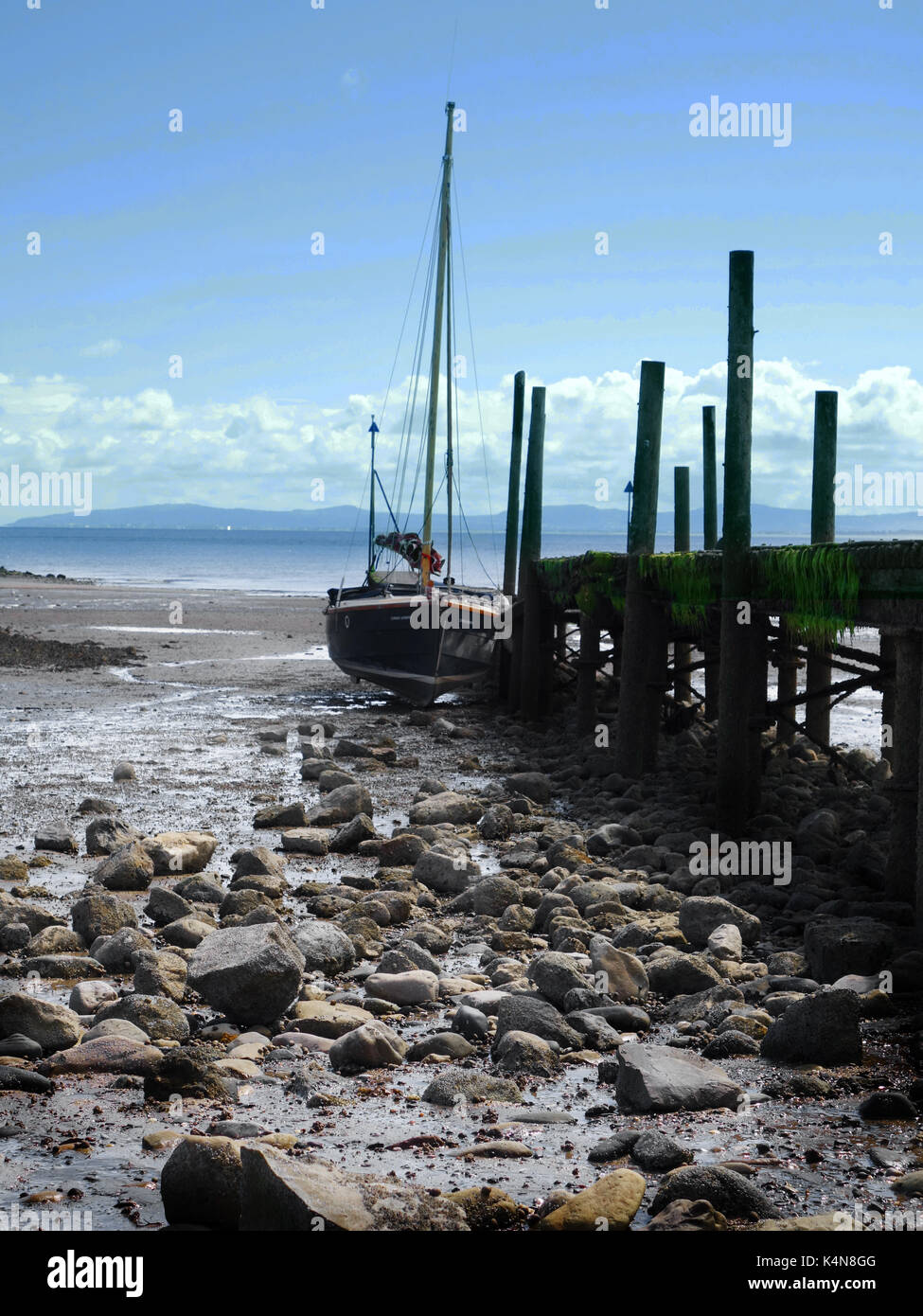 sail boat moored on beach Stock Photo