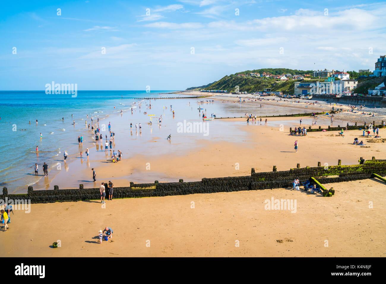 HUNSTANTON, NORFOLK, UK - AUGUST 26 2017: View of the beach in Hunstanton, Norfolk. Tourists and locals enjoy beautiful, - Stock Photo