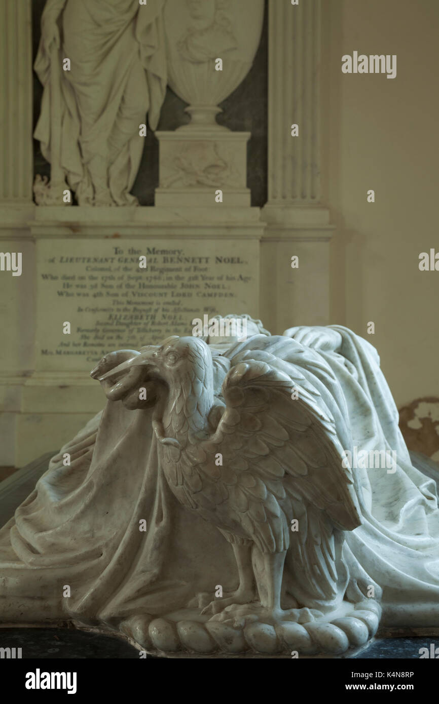 Intricately carved Eagle with a snake forming part of a black and white marble tomb within the church of St Peter & St Paul, Exton, Rutland, England. - Stock Image
