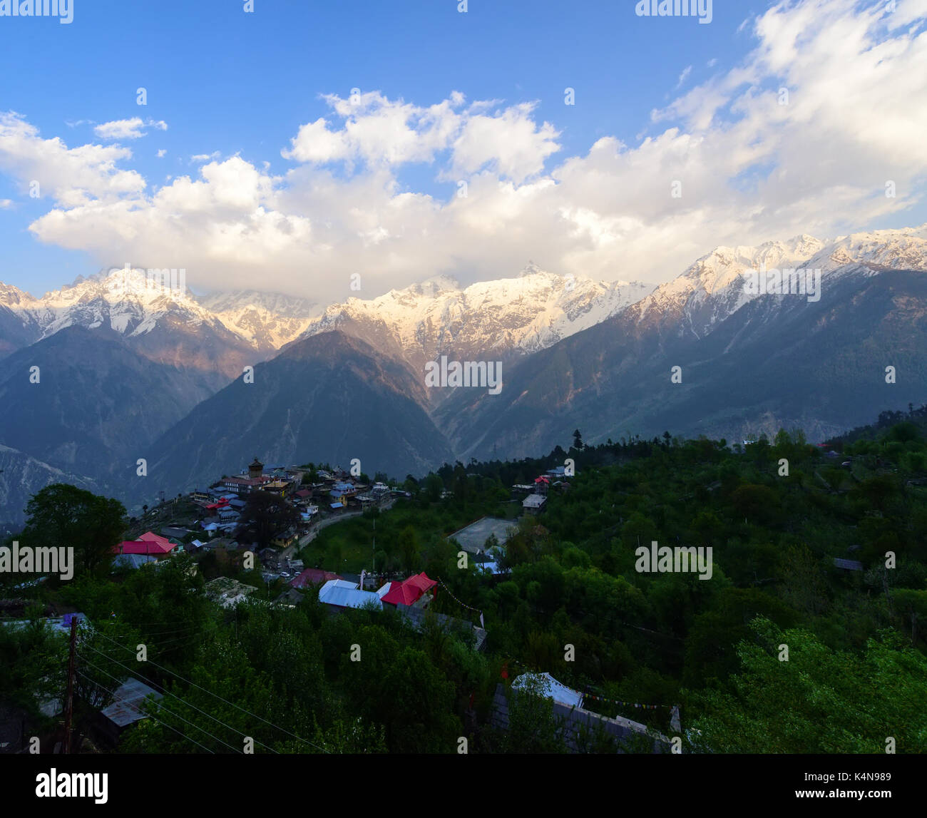 Kalpa village and Kinnaur Kailash sacred peak at sunrise view - Stock Image