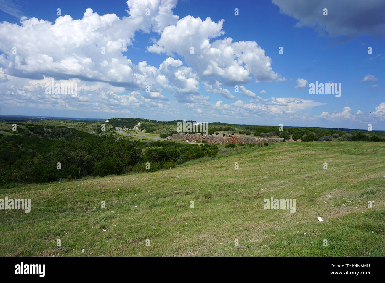 Puffy Clouds over a scenic turnout and rest area near Davis, OK - Stock Image
