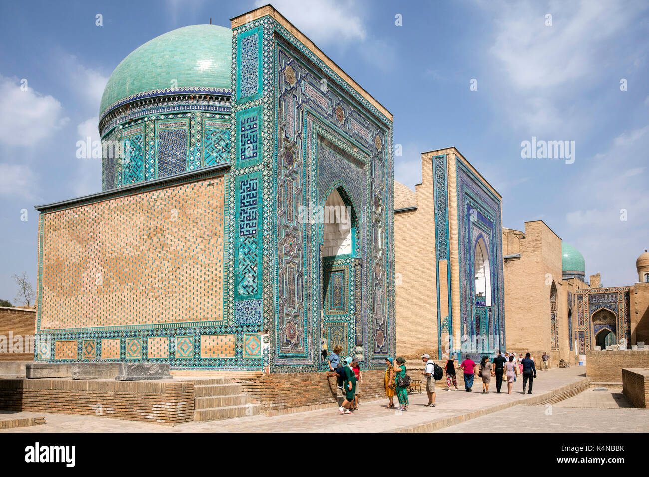 Tourists visiting Shah-i-Zinda, necropolis in the north-eastern part of Samarkand, Uzbekistan - Stock Image