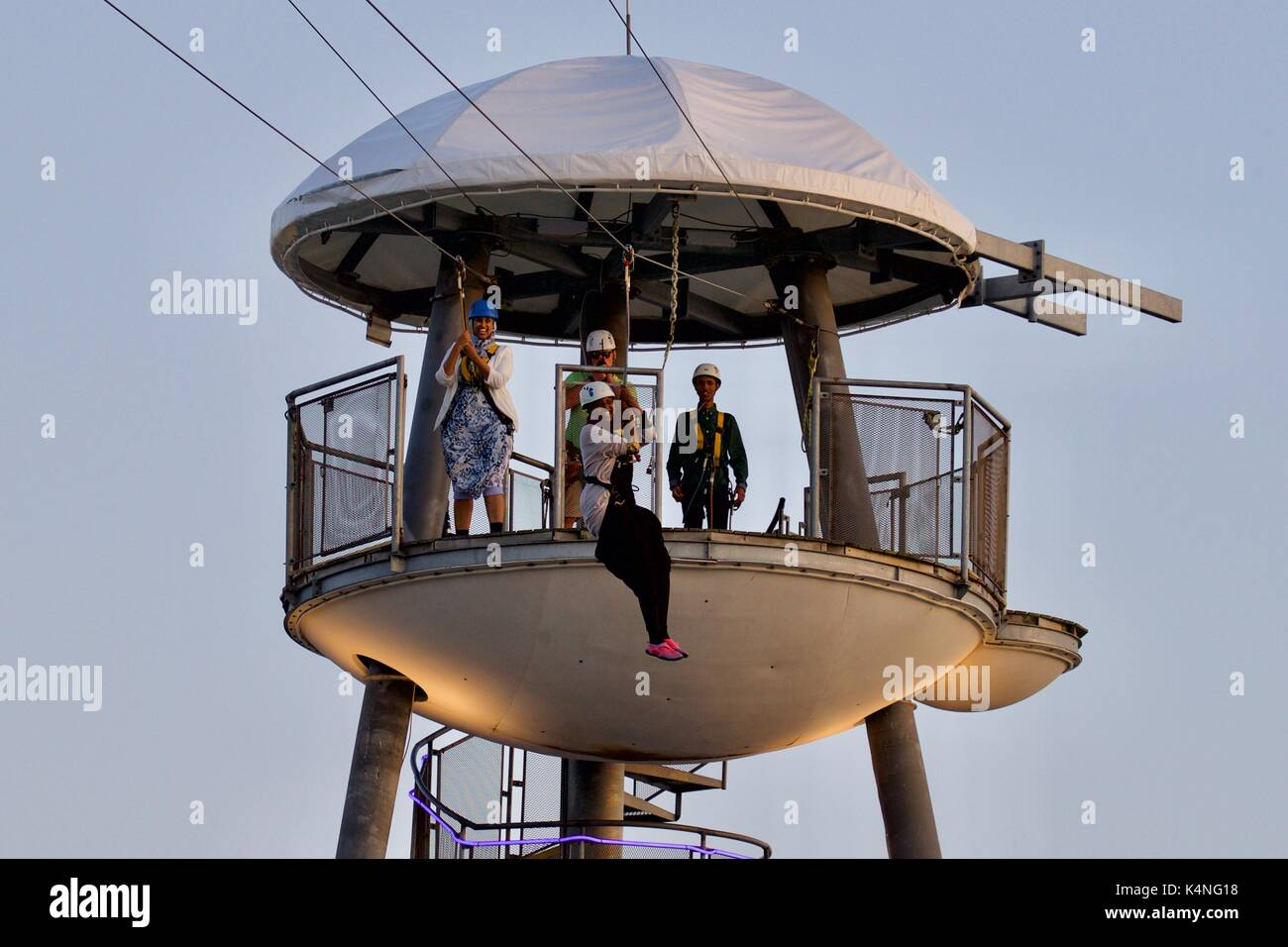 Thrill-seekers on Bournemouth zip wire - Stock Image