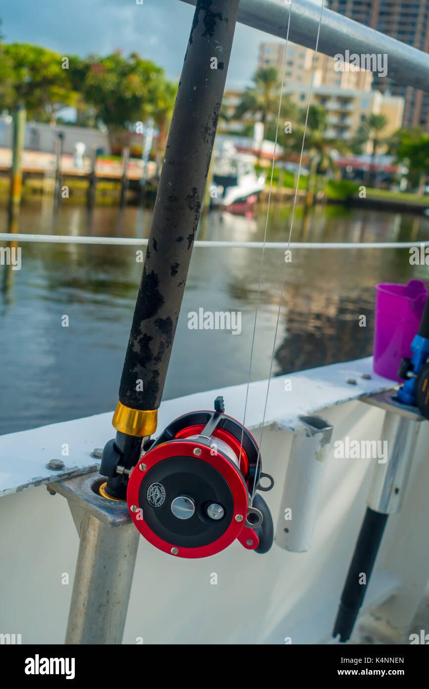 FORT LAUDERDALE, USA - JULY 11, 2017: Close up of a fishing rod in a big boat in the water at Fort Lauderdale, Florida Stock Photo