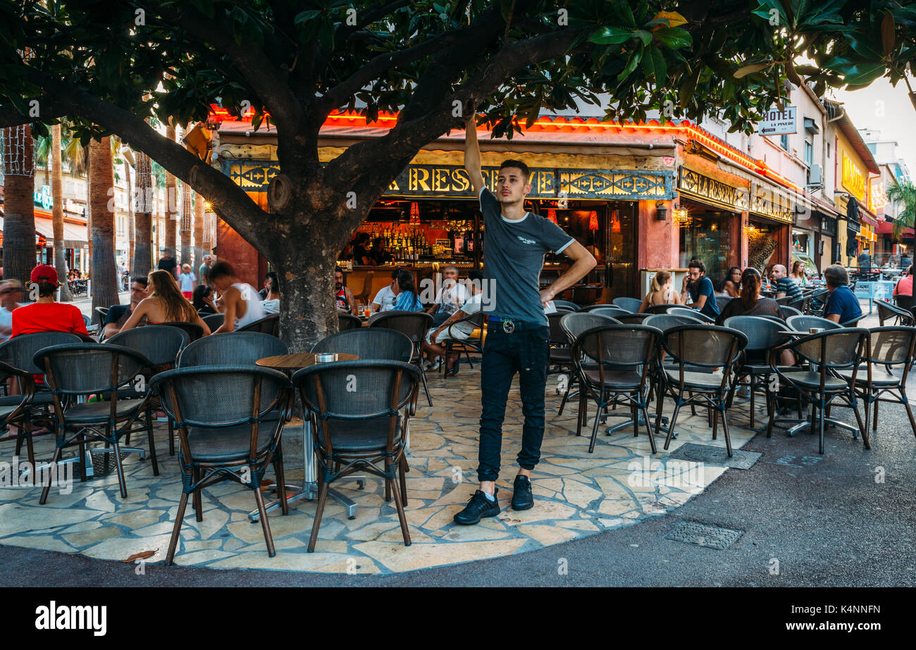 A waiter poses for a picture in Juan les Pins, Cote d'Azur, France - Stock Image