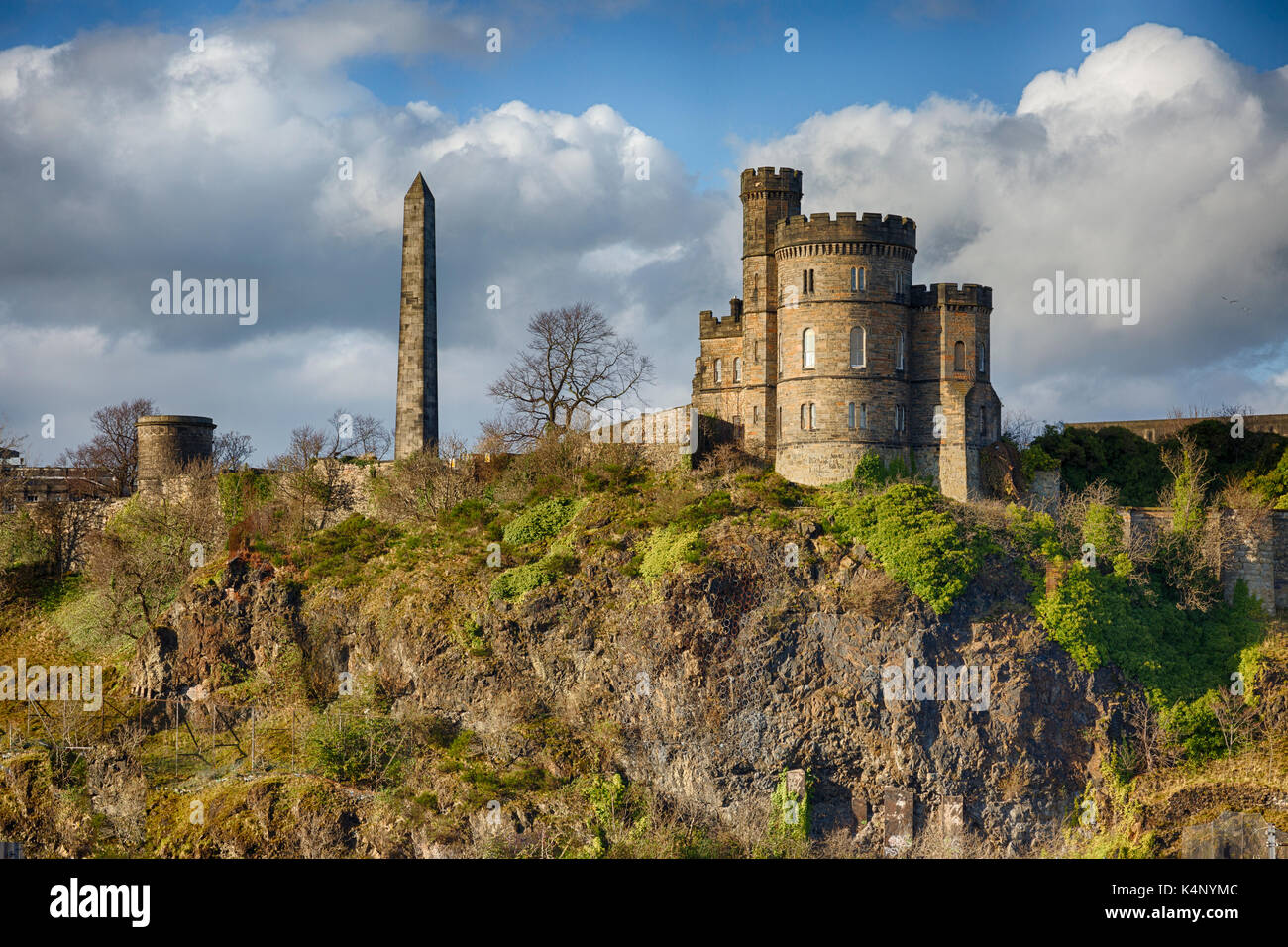 View of Calton Hill in Edinburgh Scotland with Martyr's Monument and Governors House in the Foreground Stock Photo