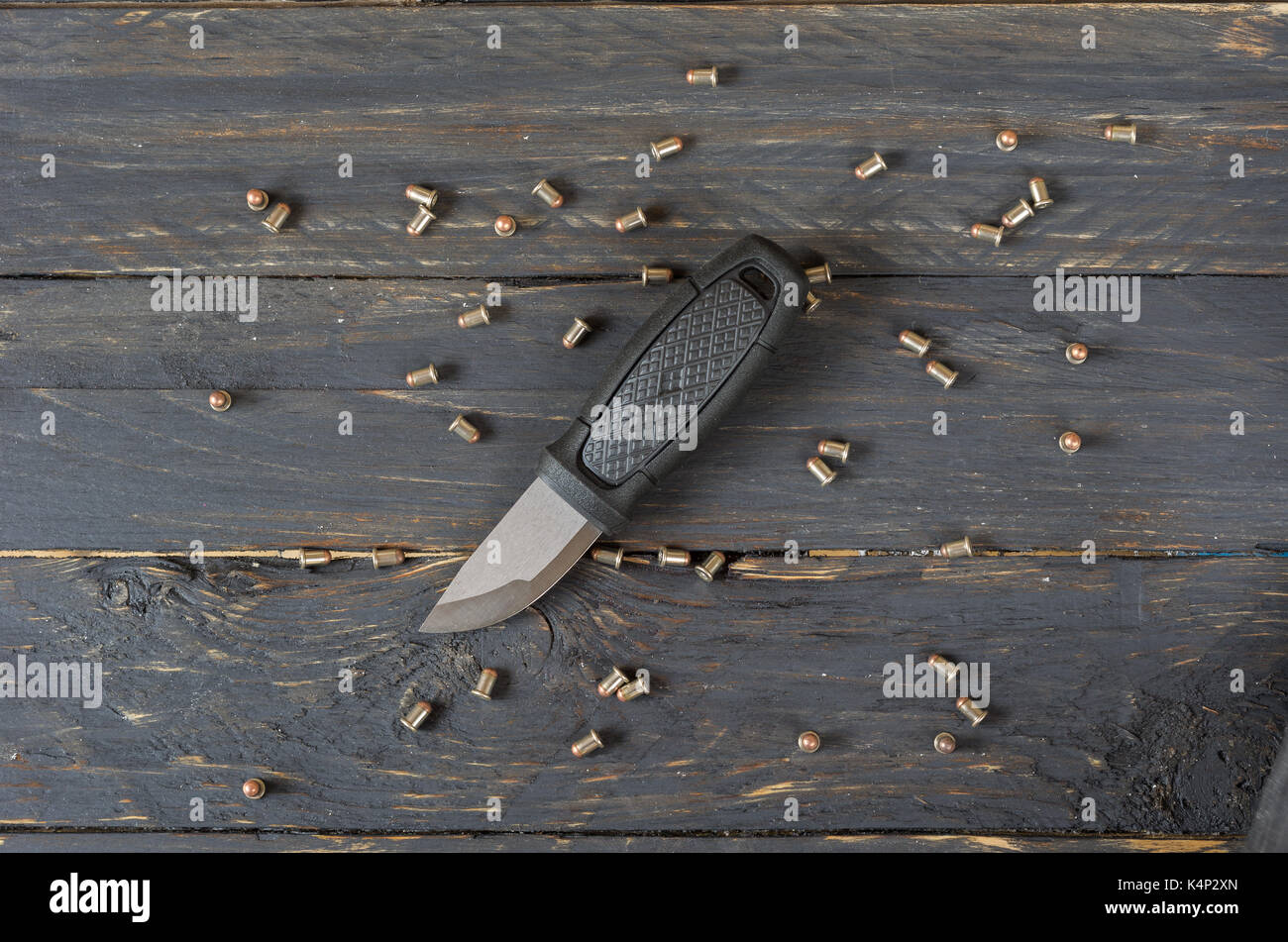 Knife and a lot of small cartridges. Stock Photo
