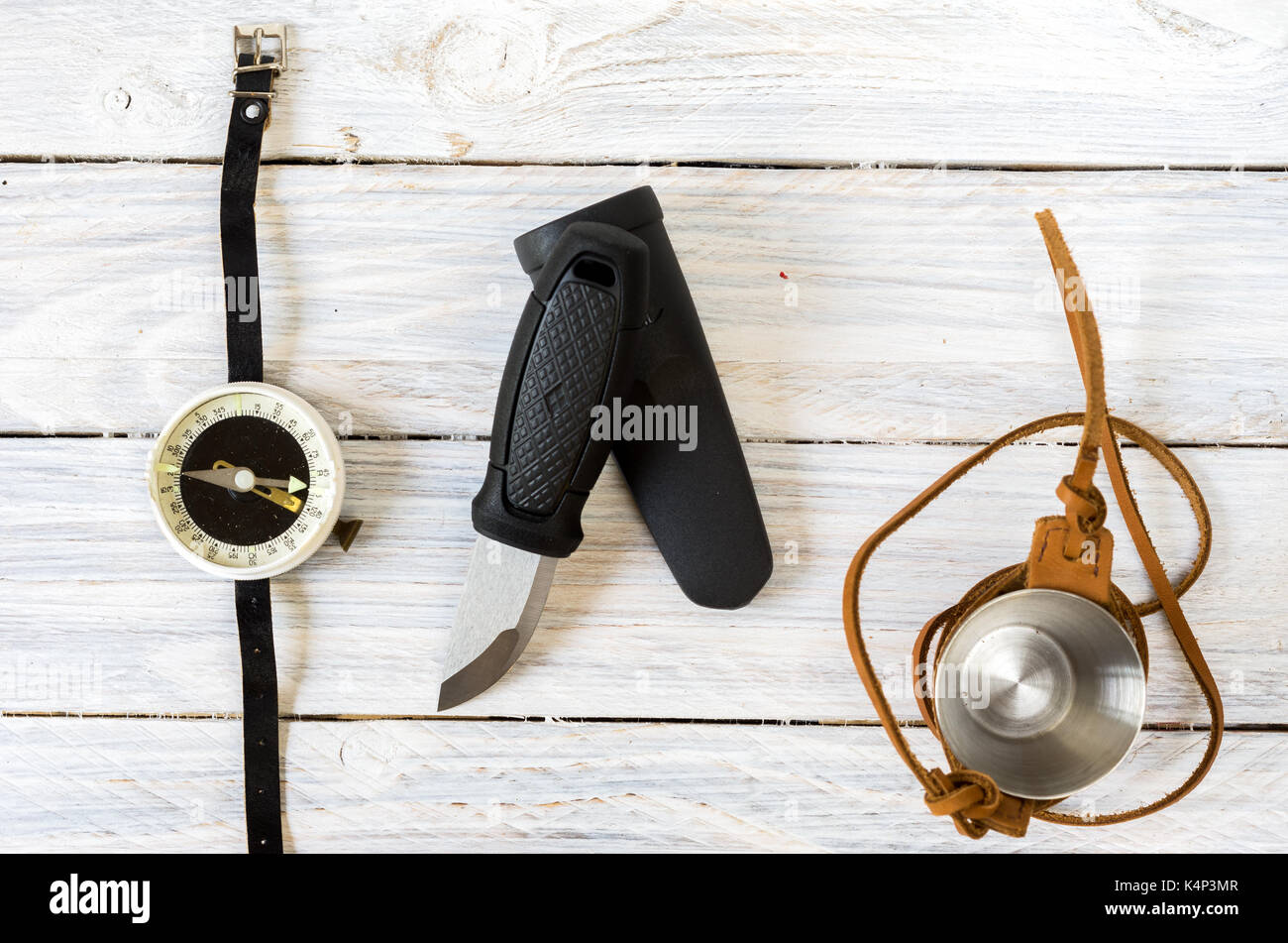 Knife with a fixed blade. A glass in a leather case. Compass for tourism. - Stock Image