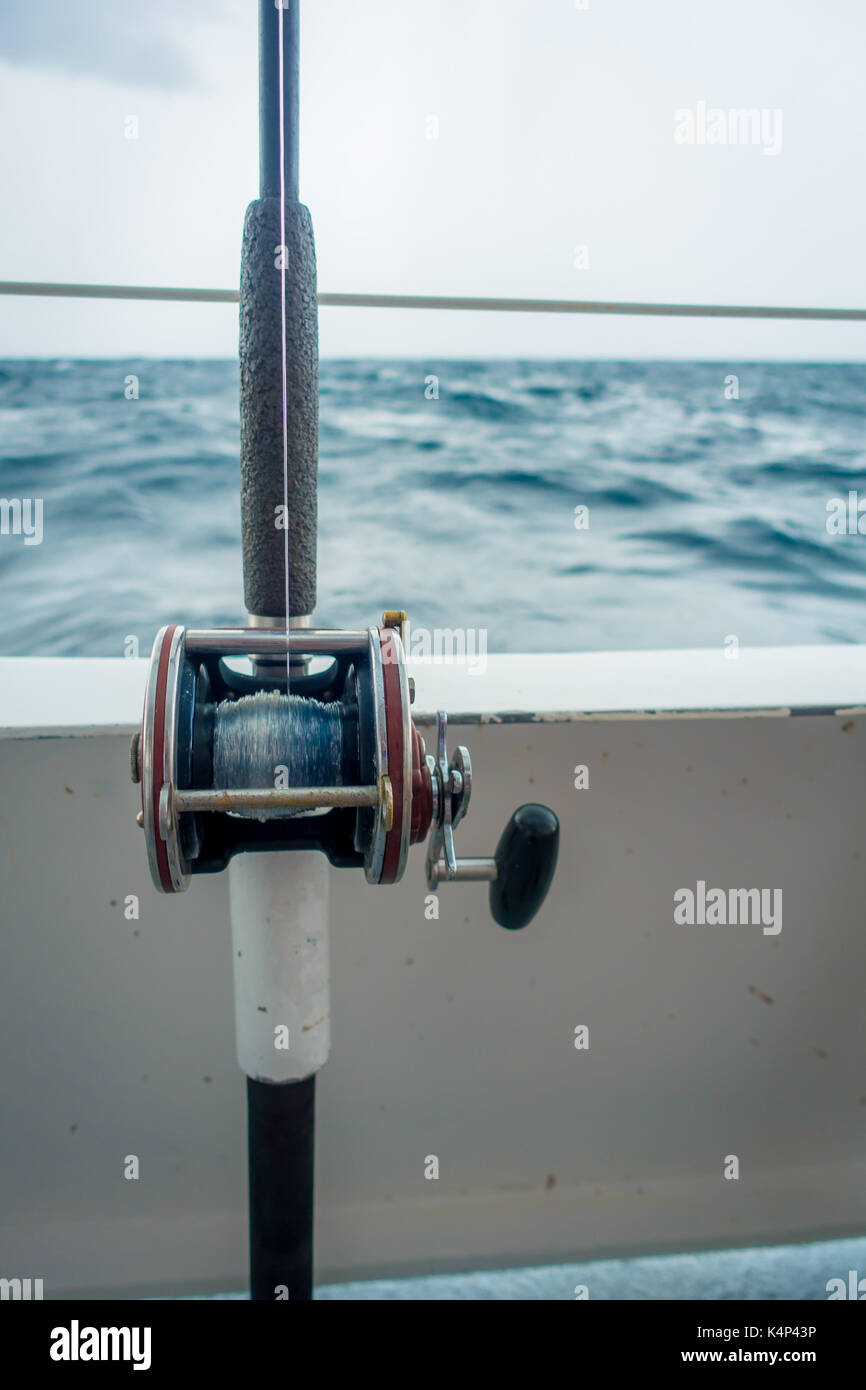 Close up of a fishing rod in a big boat in the water at Fort Lauderdale, Florida Stock Photo