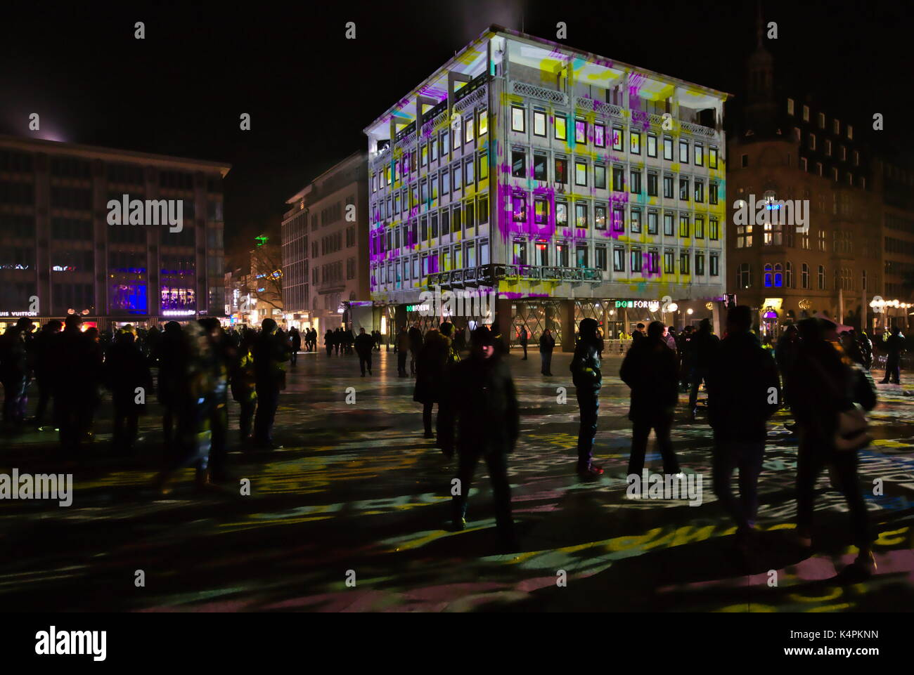 Light installation around the cologne cathedral, words and facades - Stock Image