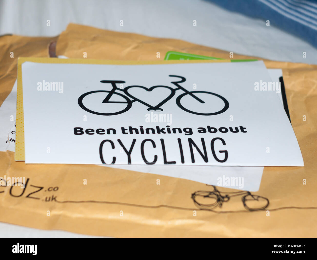 paper poster been thinking about cycling campaign graphic resource; Essex; England; UK - Stock Image