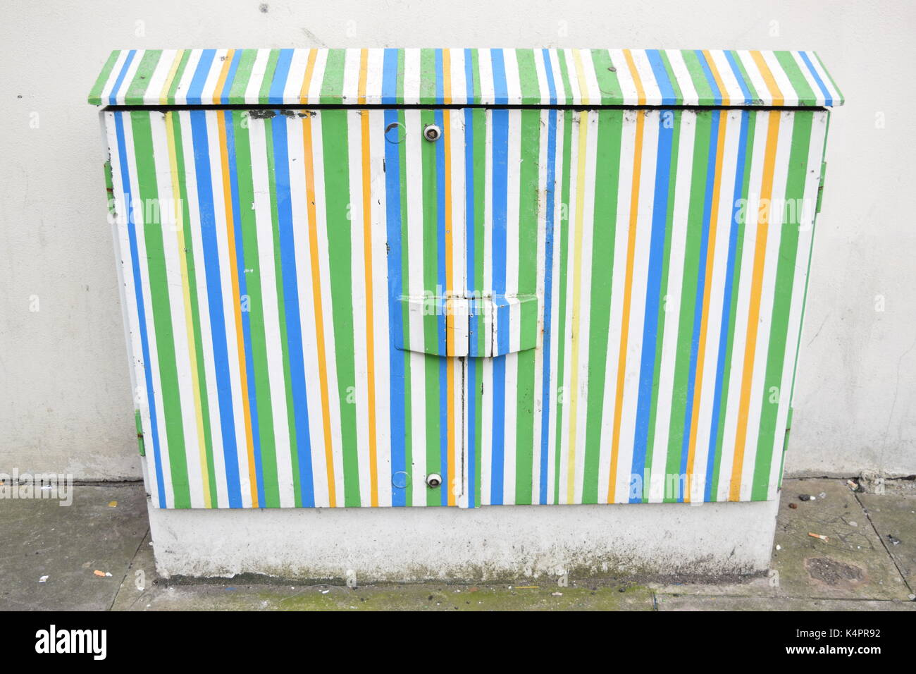 Electric meter painted outdoors - Stock Image