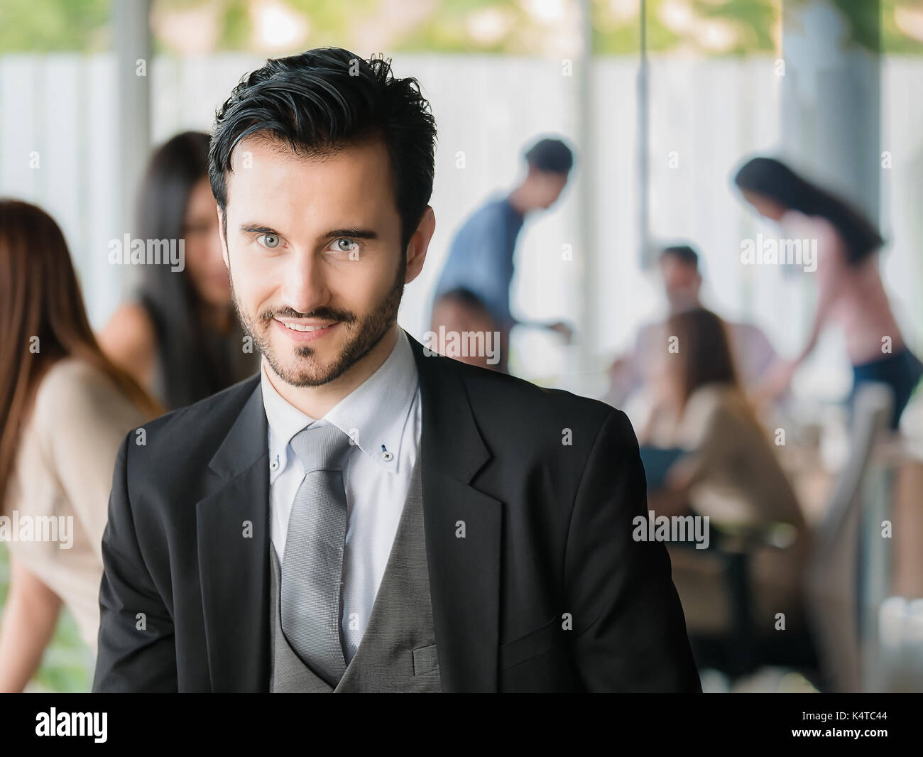 Happy businessman looking at the camera,office worker,business decisions - Stock Image