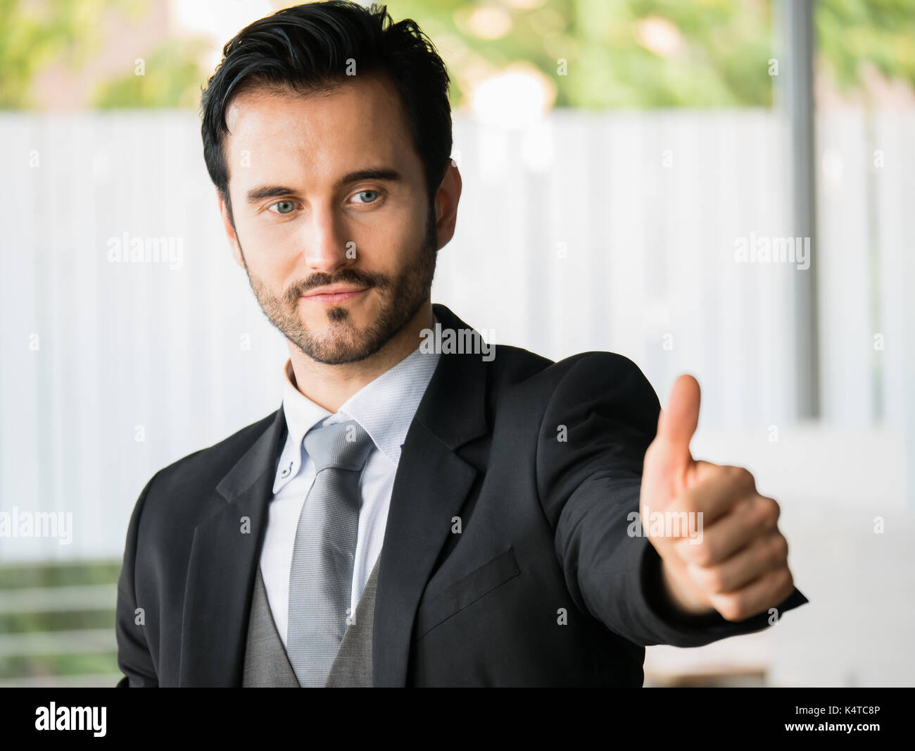 Successful businessman showing thumb up,office worker,business decisions - Stock Image