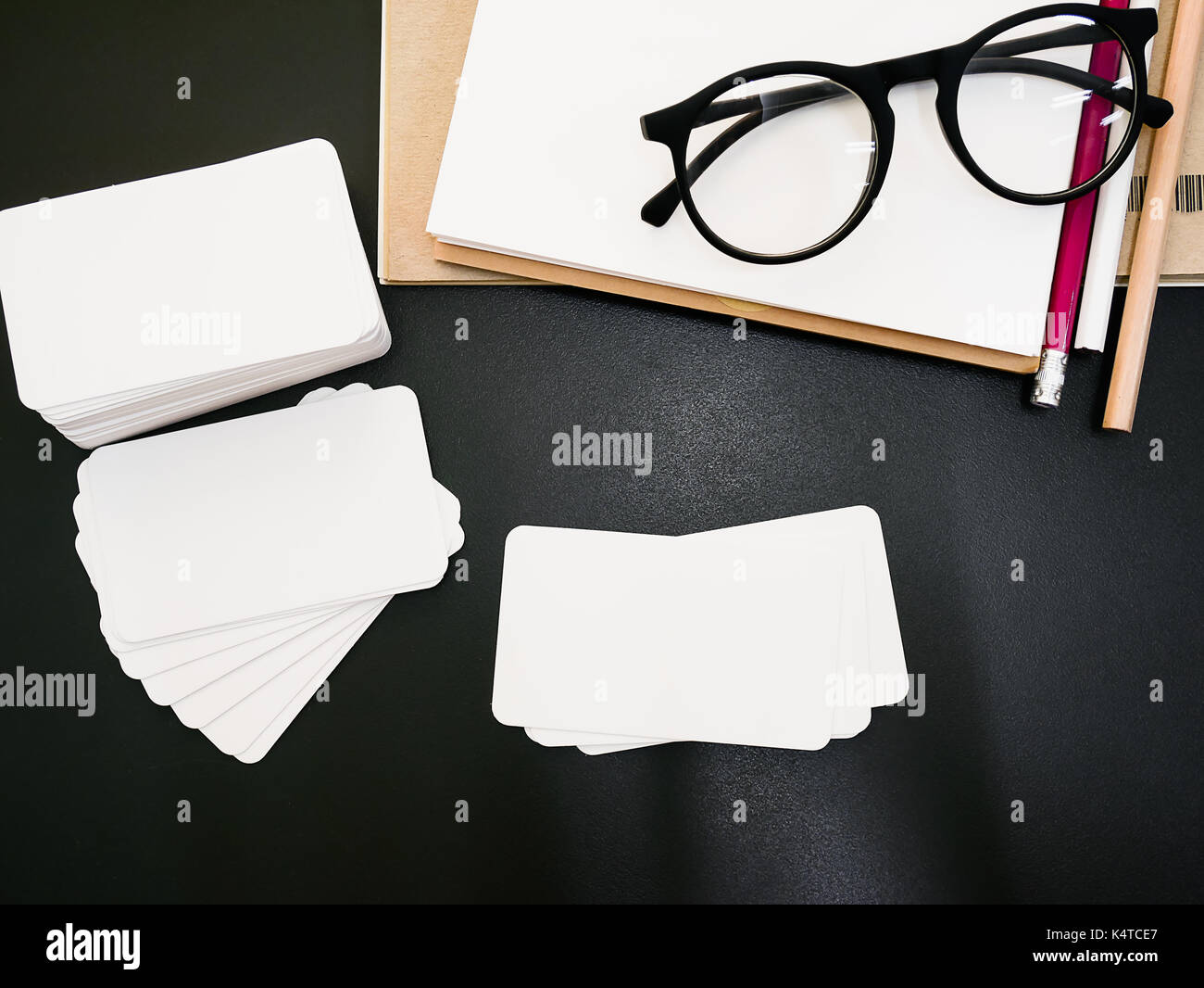 Blank corporate identity business card package on worker table - Stock Image