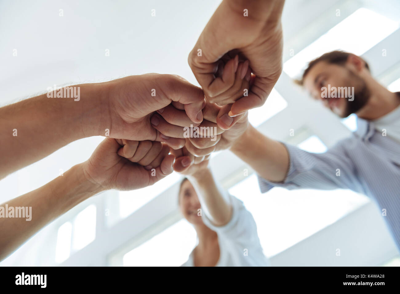 Close up of fists being held together - Stock Image