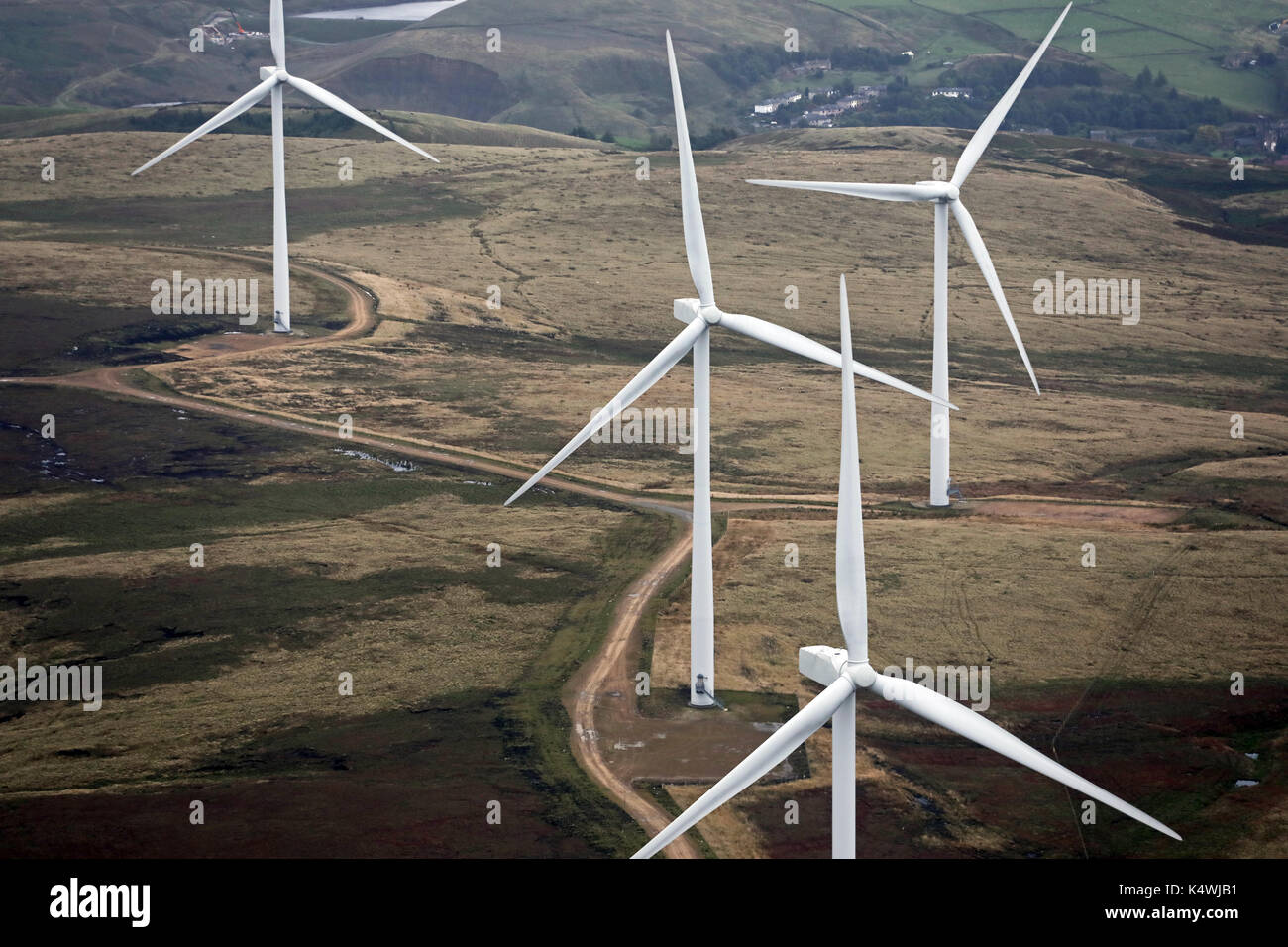 aerial view of four wind turbines on the Pennines, UK - Stock Image