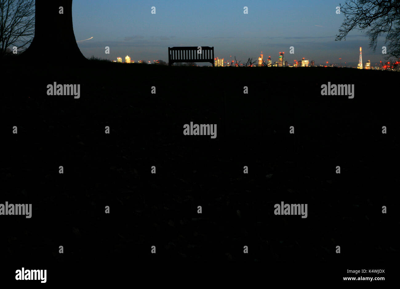 Canary Wharf and City of London panorama from the top of Hampstead Heath, Highgate, London, UK Stock Photo