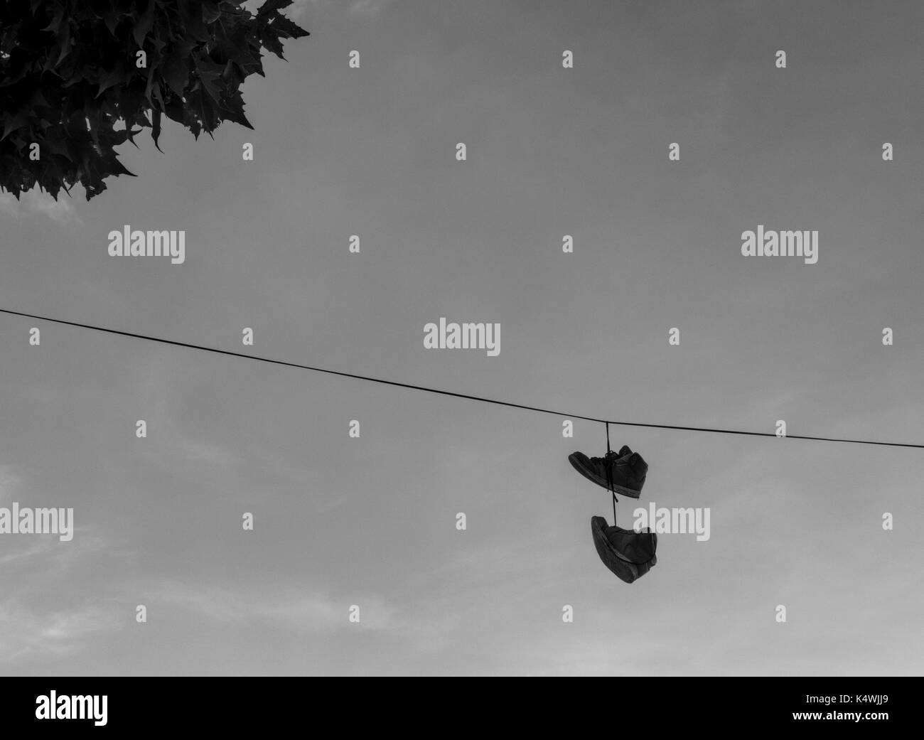 Shoes Hanging From Wire Stock Photos & Shoes Hanging From Wire Stock ...