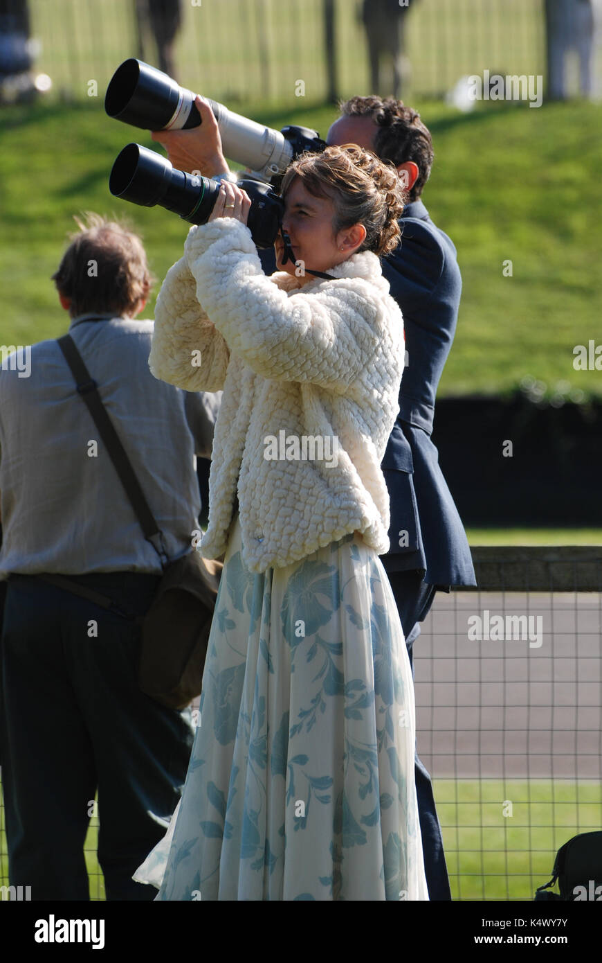 Two Photographers in Period Dress Photographing Vintage Aircraft at Goodwood revival - Stock Image