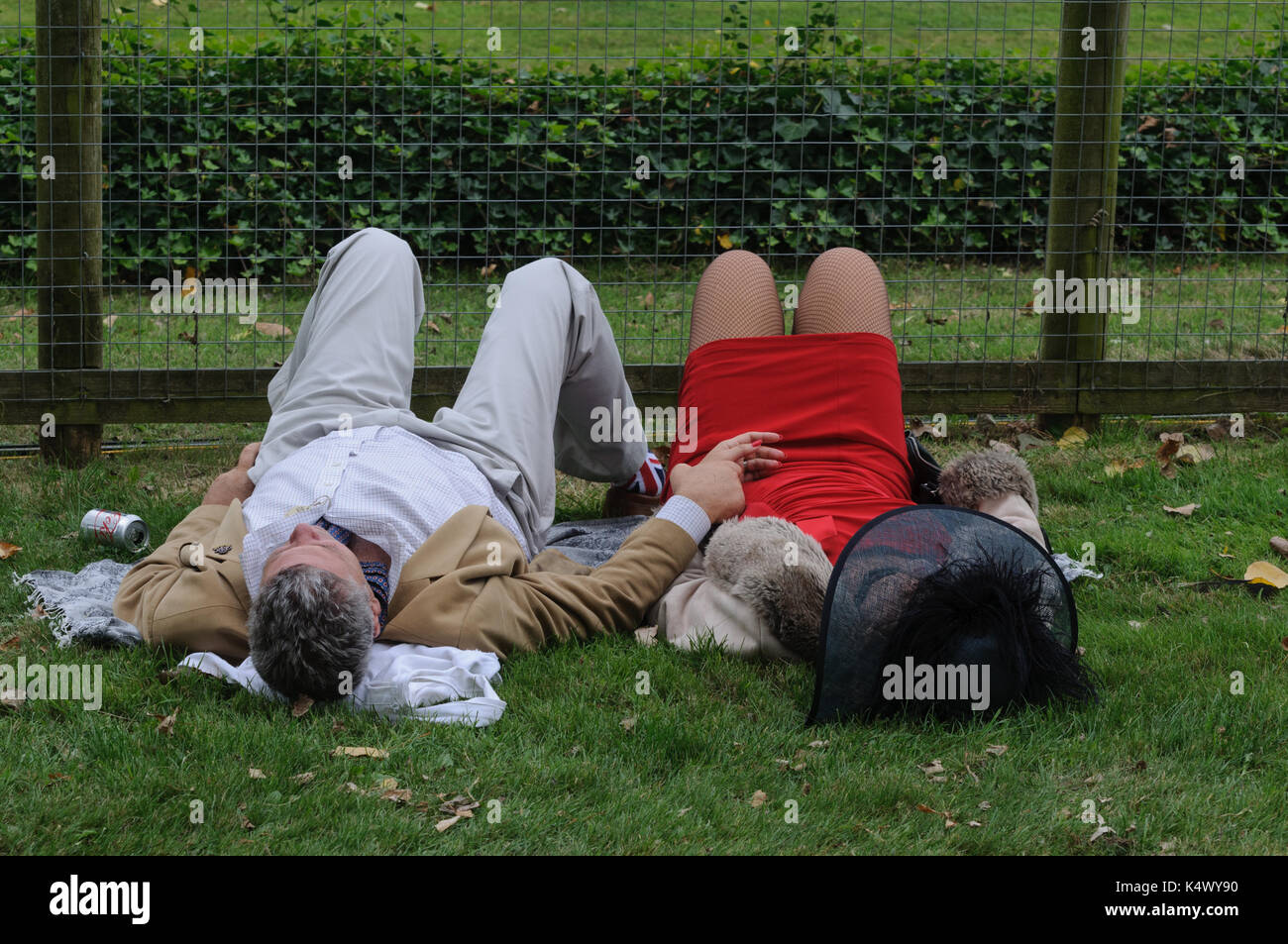 Two Spectators in Period dress Relaxing at Goodwood Revival - Stock Image