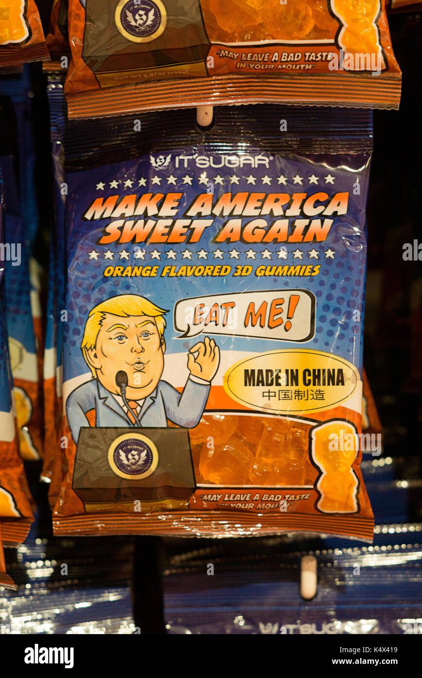 Orange flavored candy mocking Donald Trump saying Make America Eat Again. At It'sugar on Broadway in Greenwich Village, New York City. - Stock Image