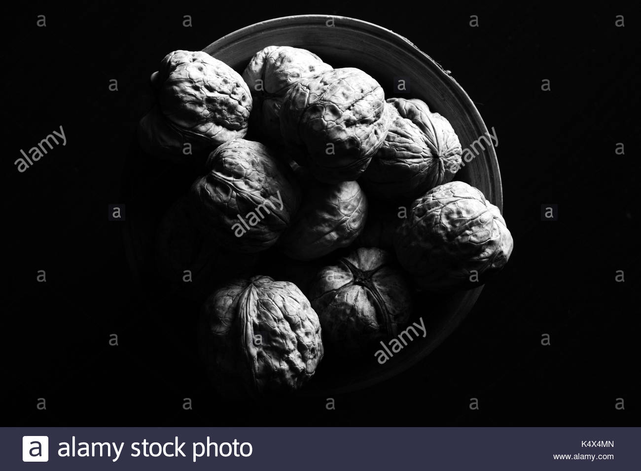 a bowl full of nuts - Stock Image