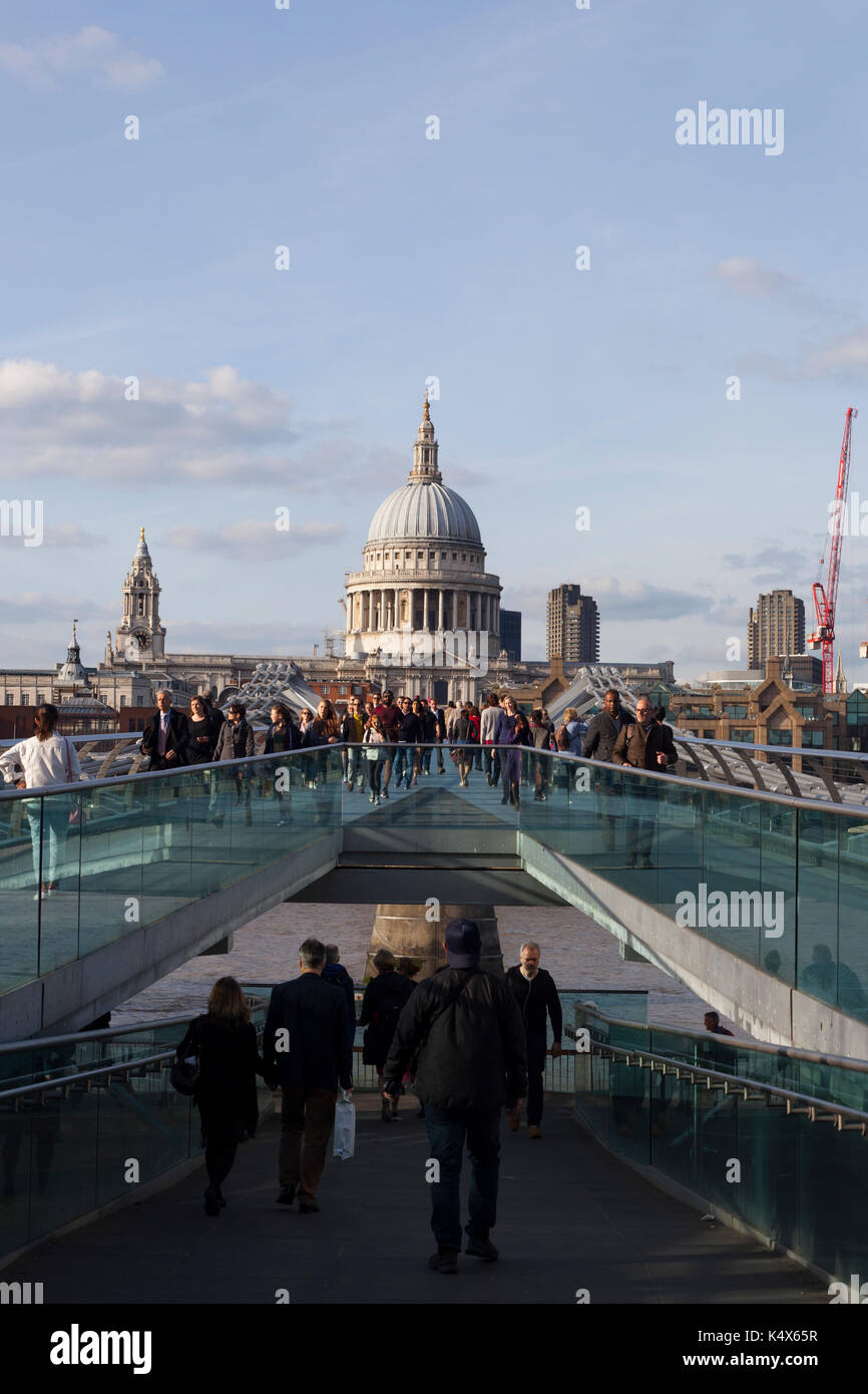 View across the Millennium Bridge, busy crowd, St Pauls Cathedral, London, UK - Stock Image