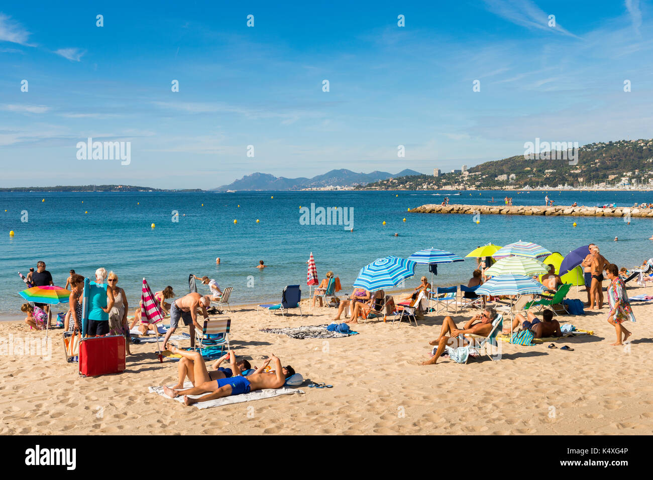 Juan les Pins, France - September 1st, 2017: Busy beach in Juan les Pins, Cote d'Azur, France. The city is famous for its annal Jazz Festival - Stock Image