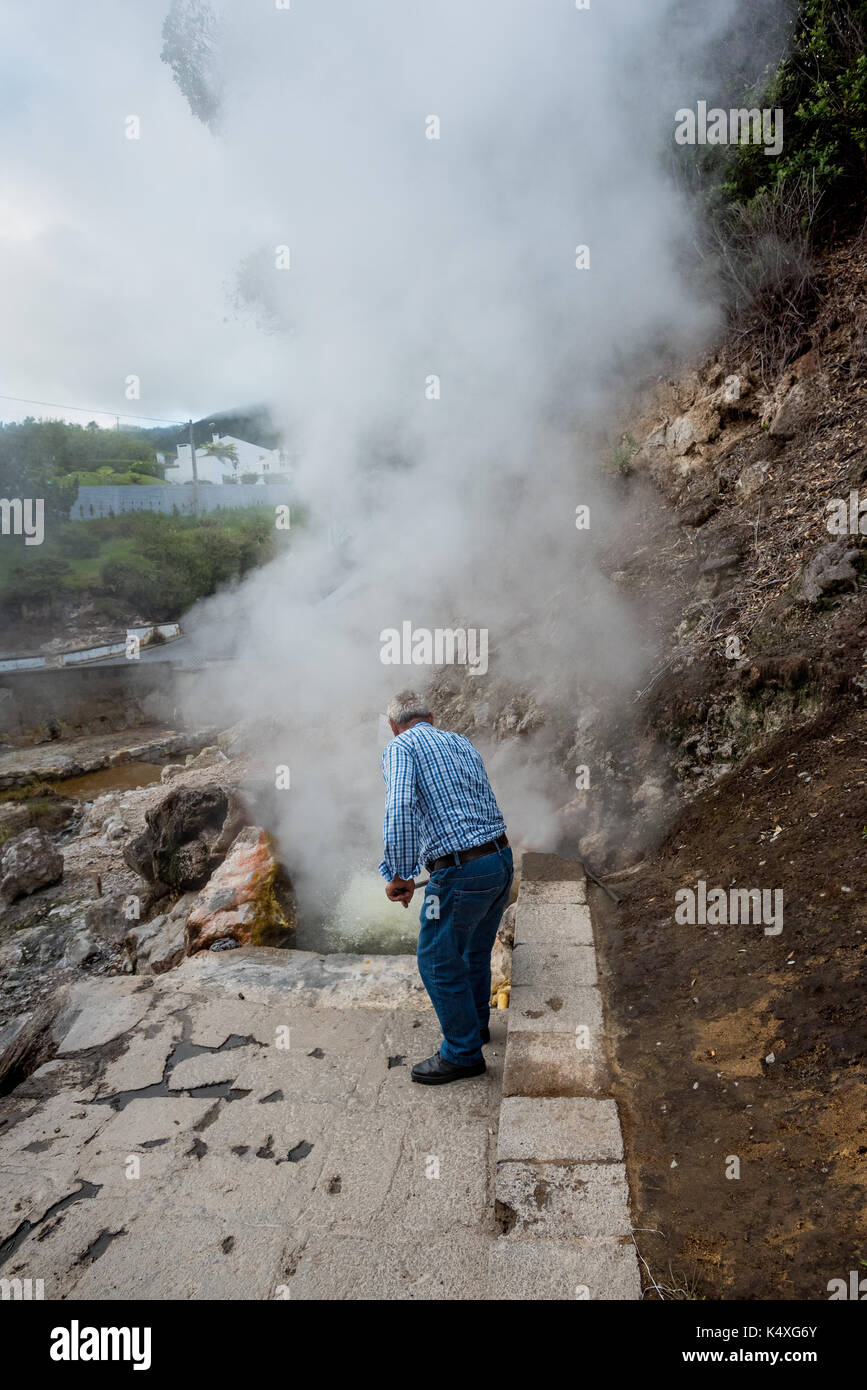 Caldeira, Furnas. Hot springs and fumaroles, people cooking in Furnas, Sao Miguel, Azores portugal - Stock Image