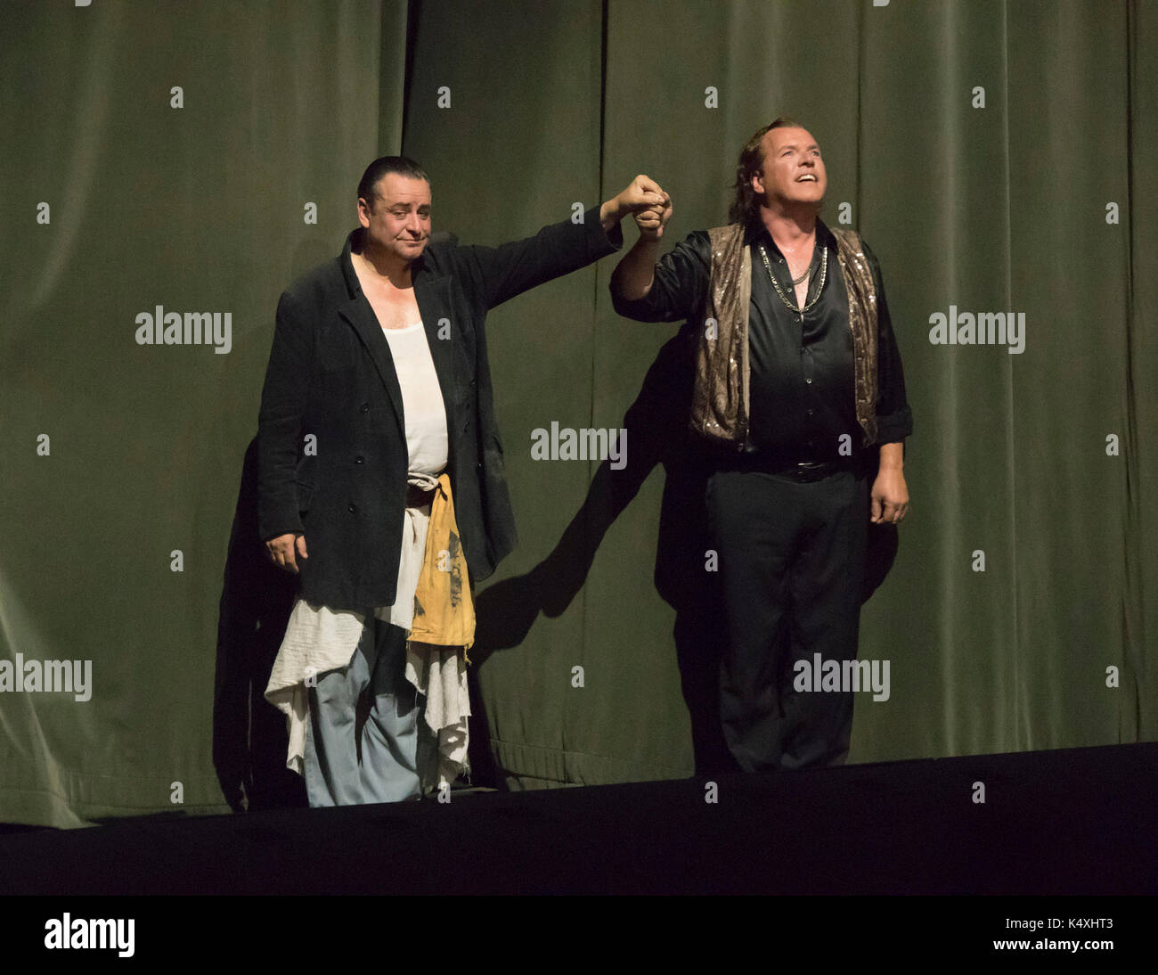 Andreas Conrad as Mime and Stefan Vinke as Siegfried taking a curtain call , Siegfried, Bayreuth Opera Festival 2017, Bavaria, Germany - Stock Image