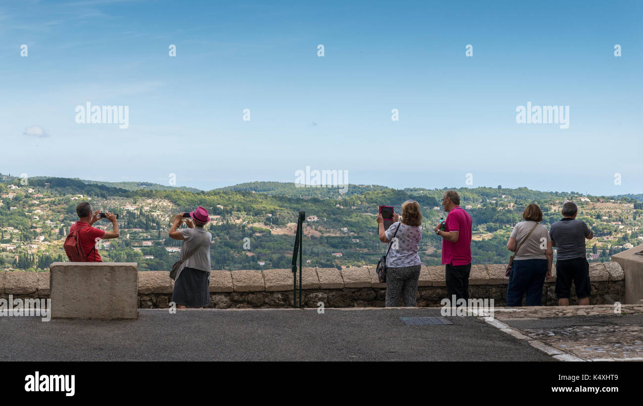 Tourists look at view in Grasse, Cote d'Azur, France. The city is famous for its perfumes - Stock Image