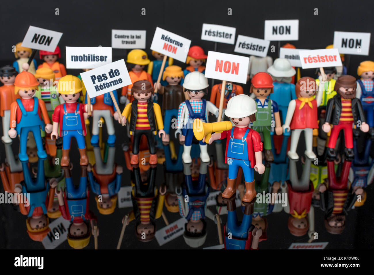 Toy figures lined up in Manif Loi Travail demo - metaphor for Strikes & CGT union's SNCF demonstrations against Emmanuel Macron's labour law reforms - Stock Image