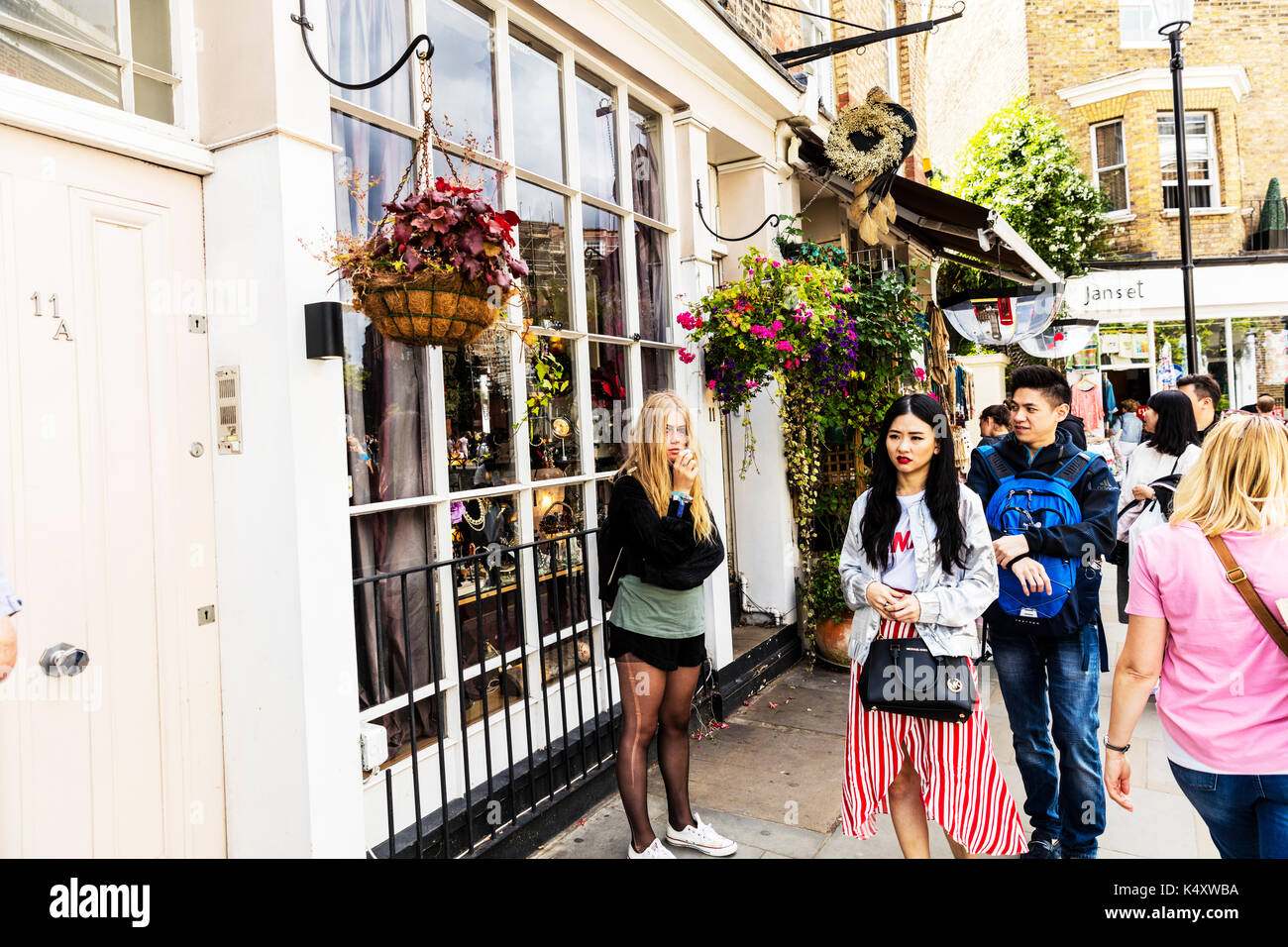 Ladder in tights, ring through nose, smoking, blonde smoking, blonde girl smoking, Portobello Road London, Portobello Road, Portobello Road people, UK - Stock Image