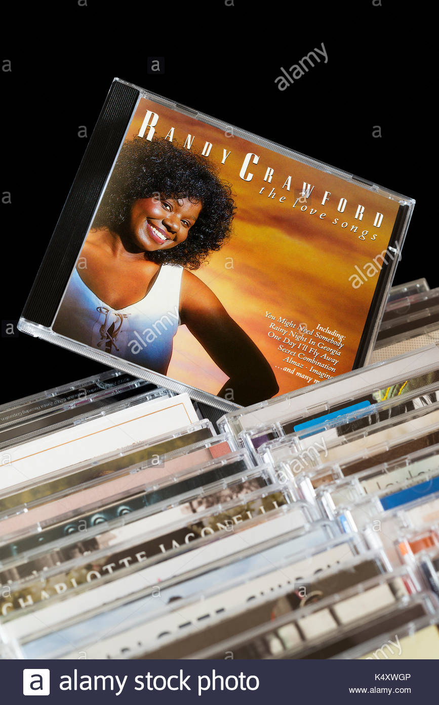 Love Songs, Randy Crawford CD pulled out from among rows of other CD's, Dorset, England - Stock Image