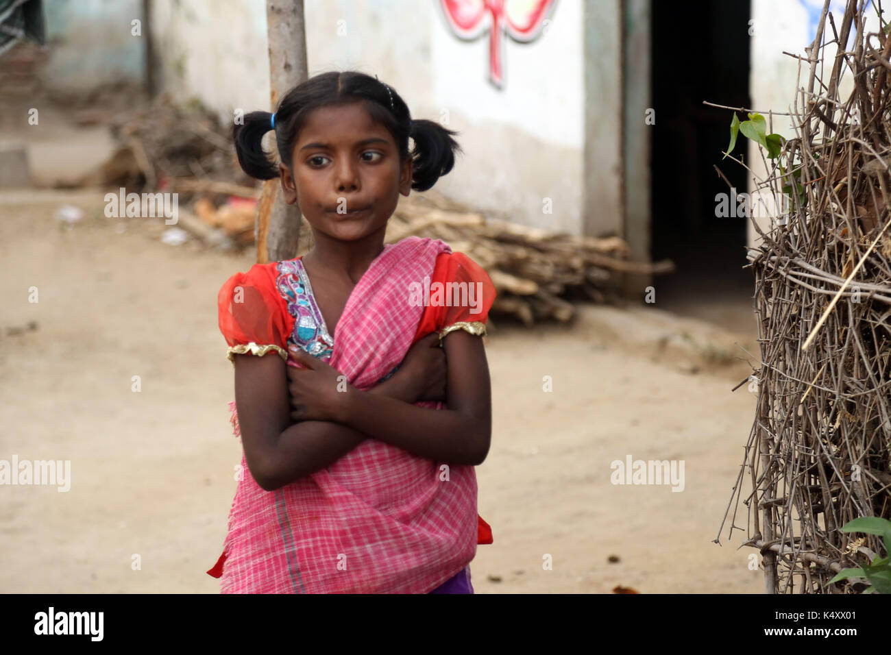 Unidentified Happy Indian rural school girl at their Village India. - Stock Image