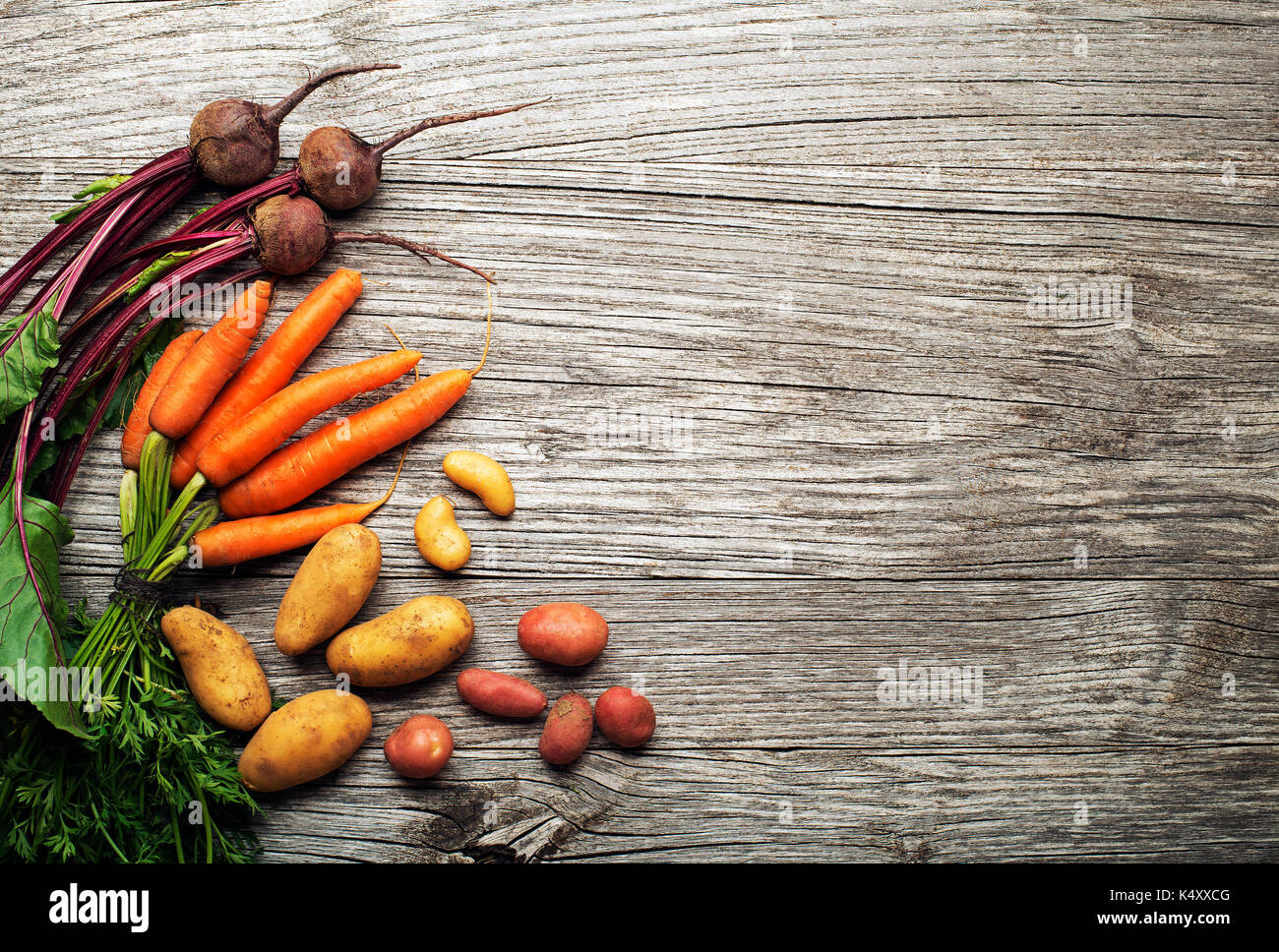 Various fresh vegetables and ingredients on wooden rustic background Stock Photo