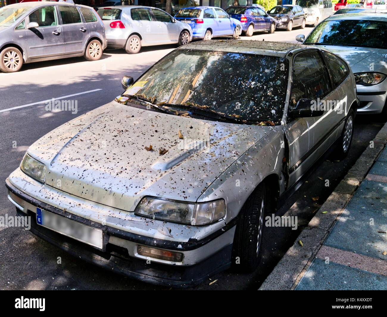 Very dirty car condition covered in bird droppings. - Stock Image