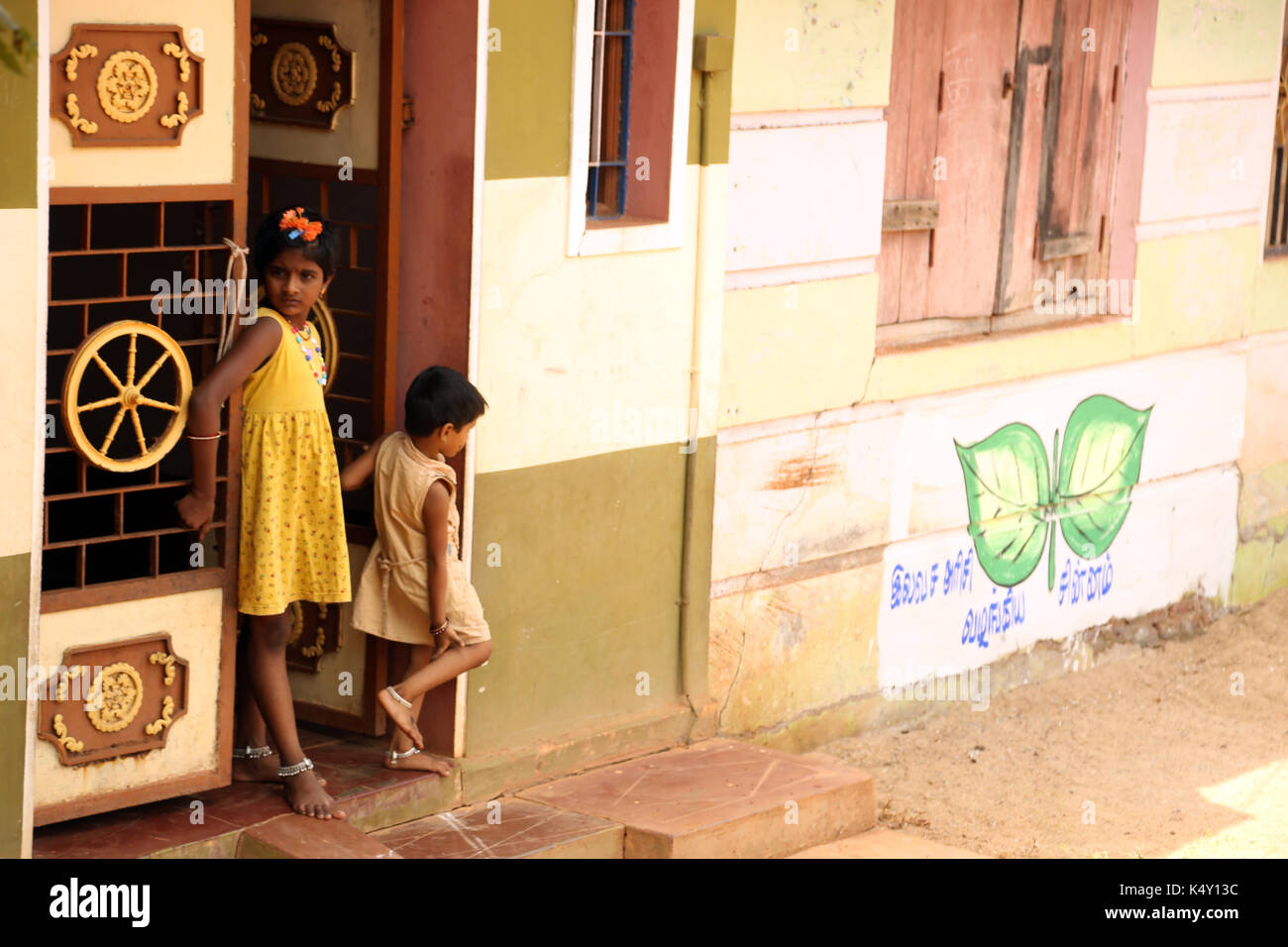 Unidentified children in rural village at India. - Stock Image