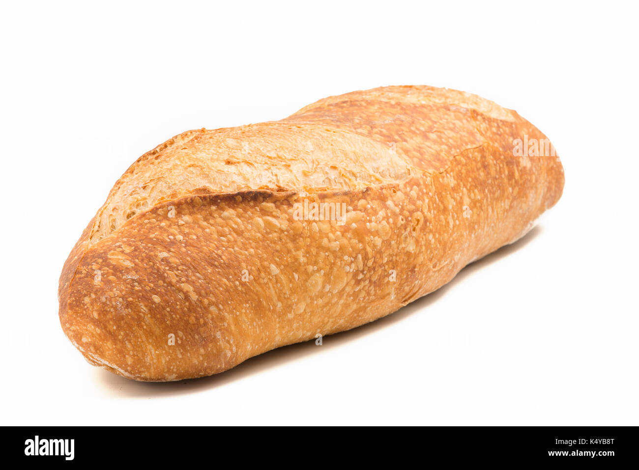 rustic wheat bread isolated on white background - Stock Image