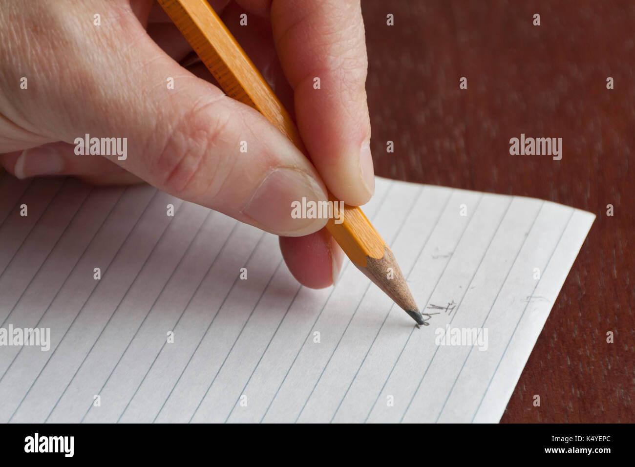 Left hand writing with a pencil - Stock Image