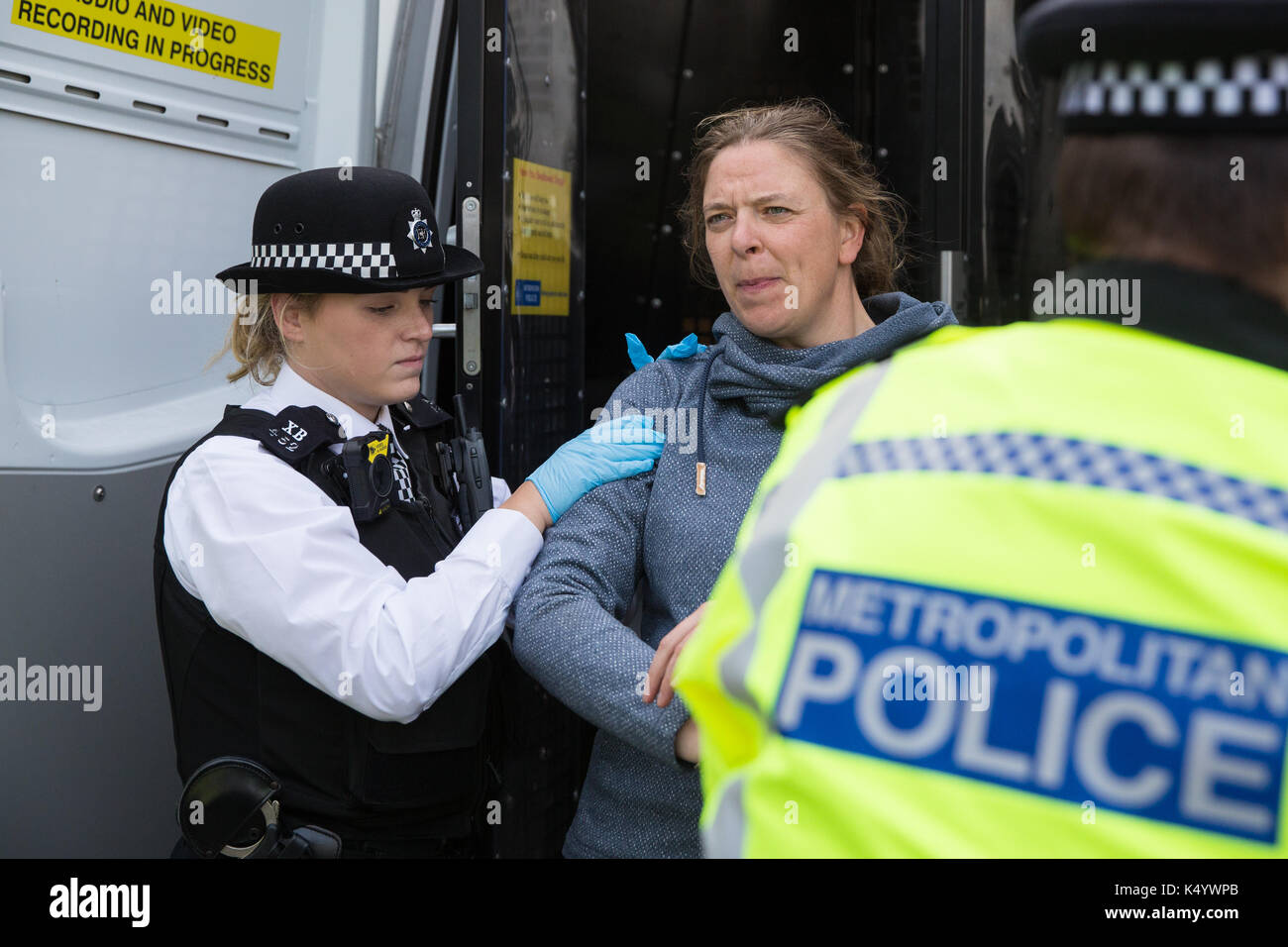London, UK. 7th Sep, 2017. A campaigner against the arms trade is arrested after locking herself onto the chassis Stock Photo
