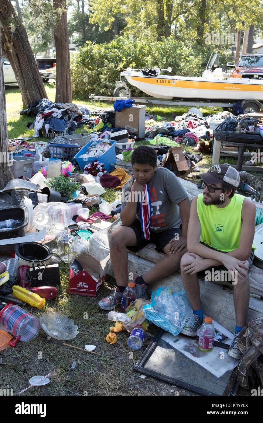 USA. 07th Sep, 2017. Baytown, Texas USA Sept. 7, 2017: Eric Grafton, Brandon Hawley and Shawn Curry sit in front Stock Photo
