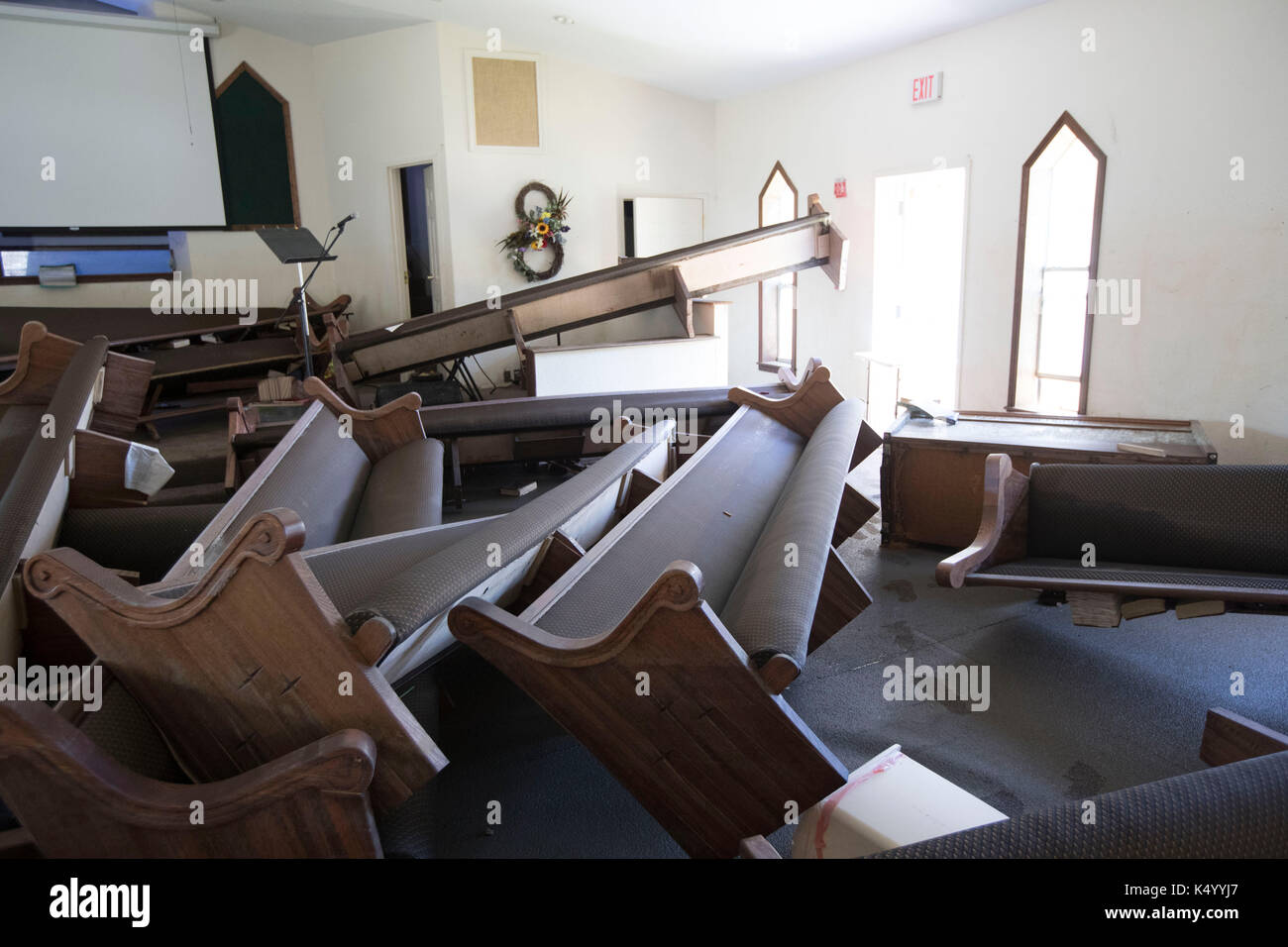 Beaumont, USA. 07th Sep, 2017. Beaumont, Texas USA Sept. 7, 2017: The Voth Baptist Church in northwest Beaumont lies in ruin after flooding inundated the church building following Hurricane Harvey almost two weeks ago. Parishoners vow to rebuild the church after the disaster. Credit: Bob Daemmrich/Alamy Live News - Stock Image