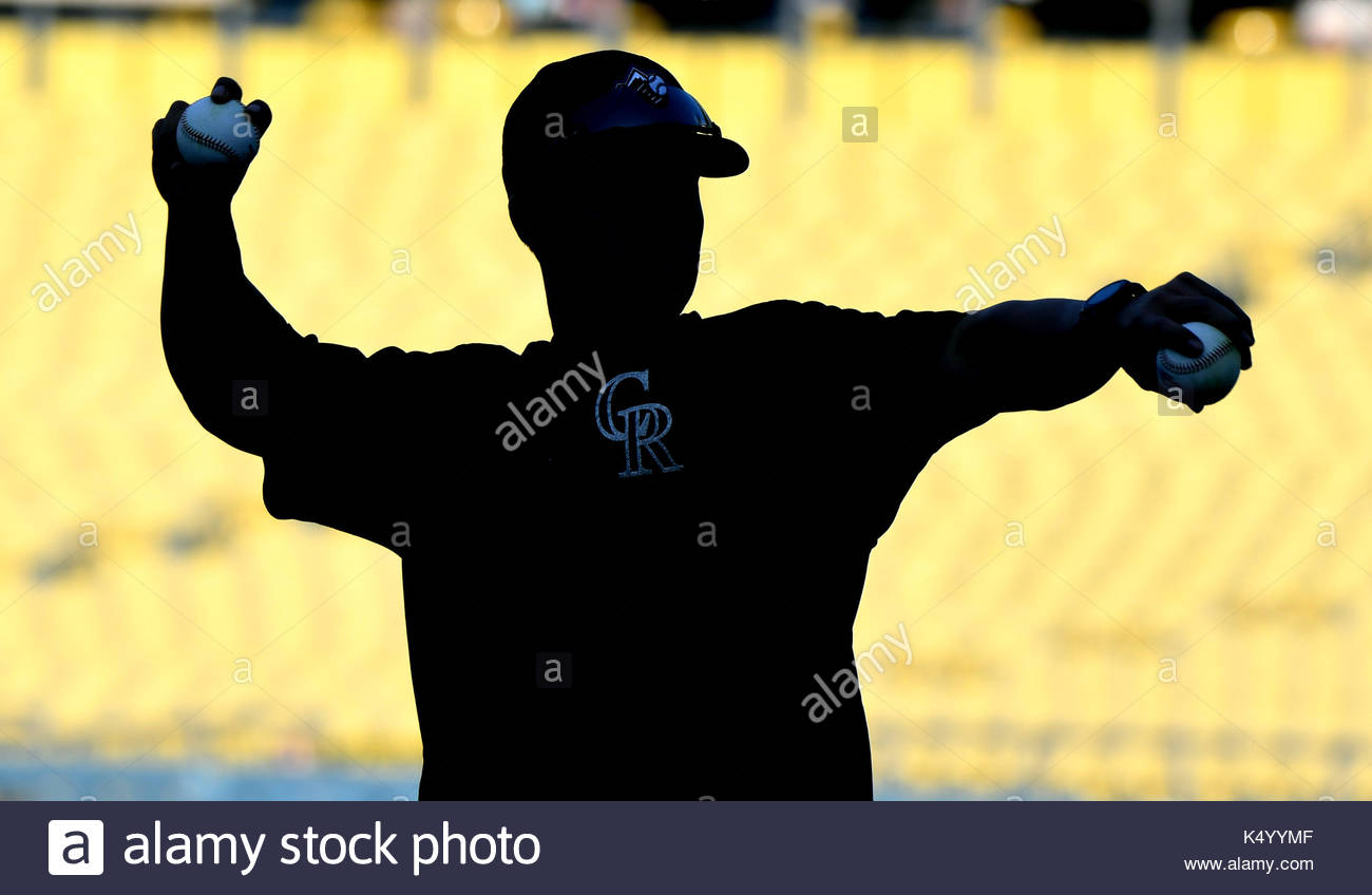 4c6b998a3 Colorado Rockies batting practice pitcher is silhouetted prior to a Major  League baseball game against the Los Angeles Dodgers at Dodger Stadium on  Thursday ...
