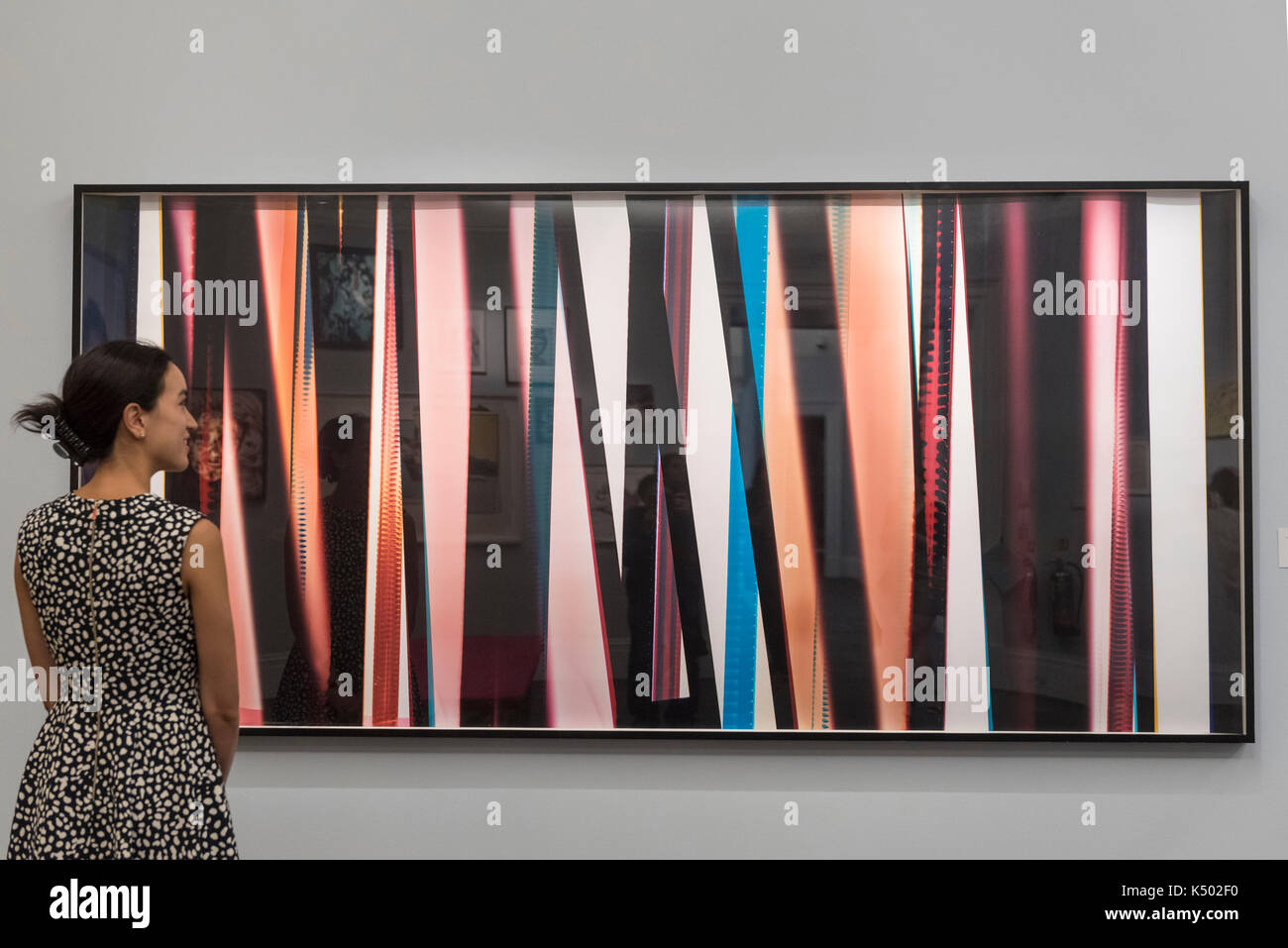 London, UK.  8 September 2017. A staff member views 'RA4 Contact Print', 2013, by Walead Beshty (Est. GBP25-35k), at a preview of 'Shake It Up', a collection of contemporary artworks from the personal collection of celebrity photographer Mario Testino. Proceeds from the upcoming auction of the collection at Sotheby's in London will benefit Museo Mate in Lima, Peru. - Stock Image
